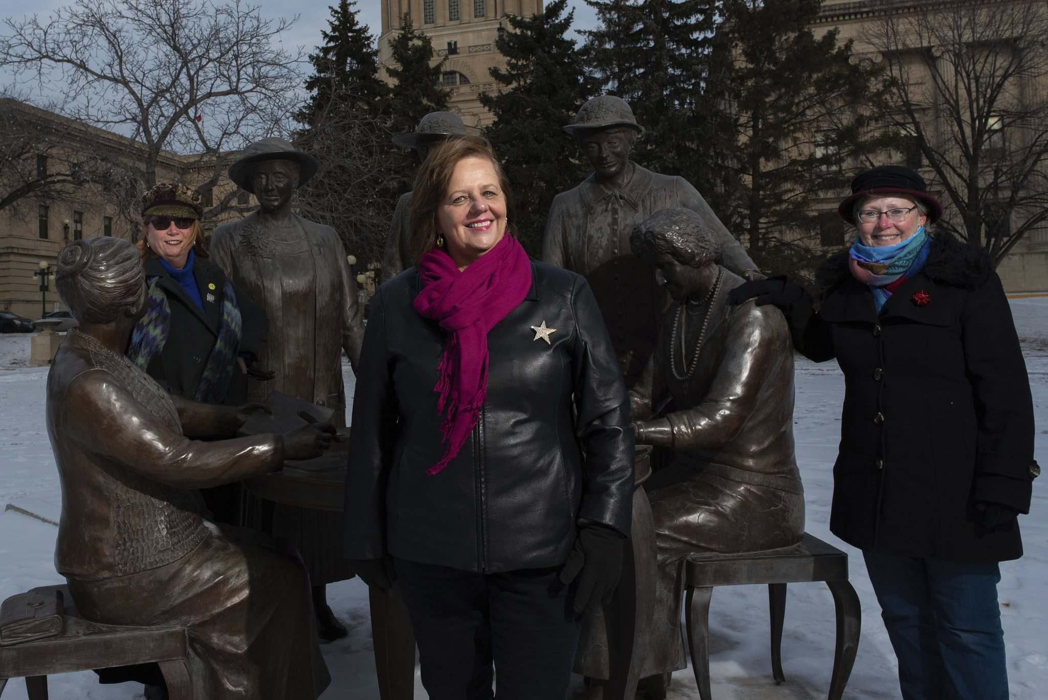 JESSE BOILY / WINNIPEG FREE PRESS</p><p>Members of local sisterhood PEO International Lynette Phyfe (from left) Karen Wiebe and Linda Hamilton, stop for a photo next to the Famous Five Monument.</p>