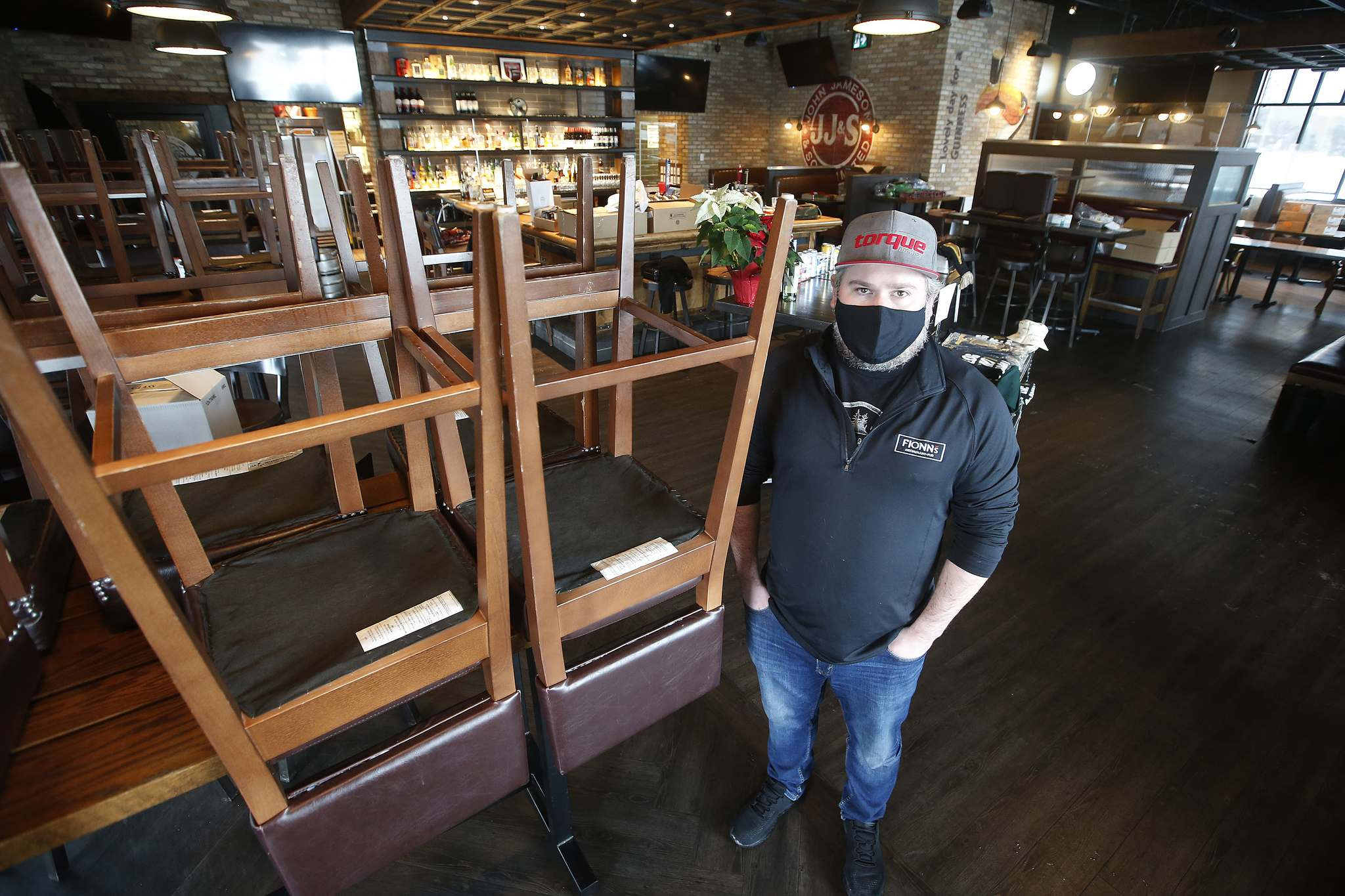 Jay Kilgour, owner of Fionn MacCool's, says relief from the high costs of delivery apps, which is responsible for 65 per cent of his two restaurant's sales, is welcome. (John Woods / Winnipeg Free Press)