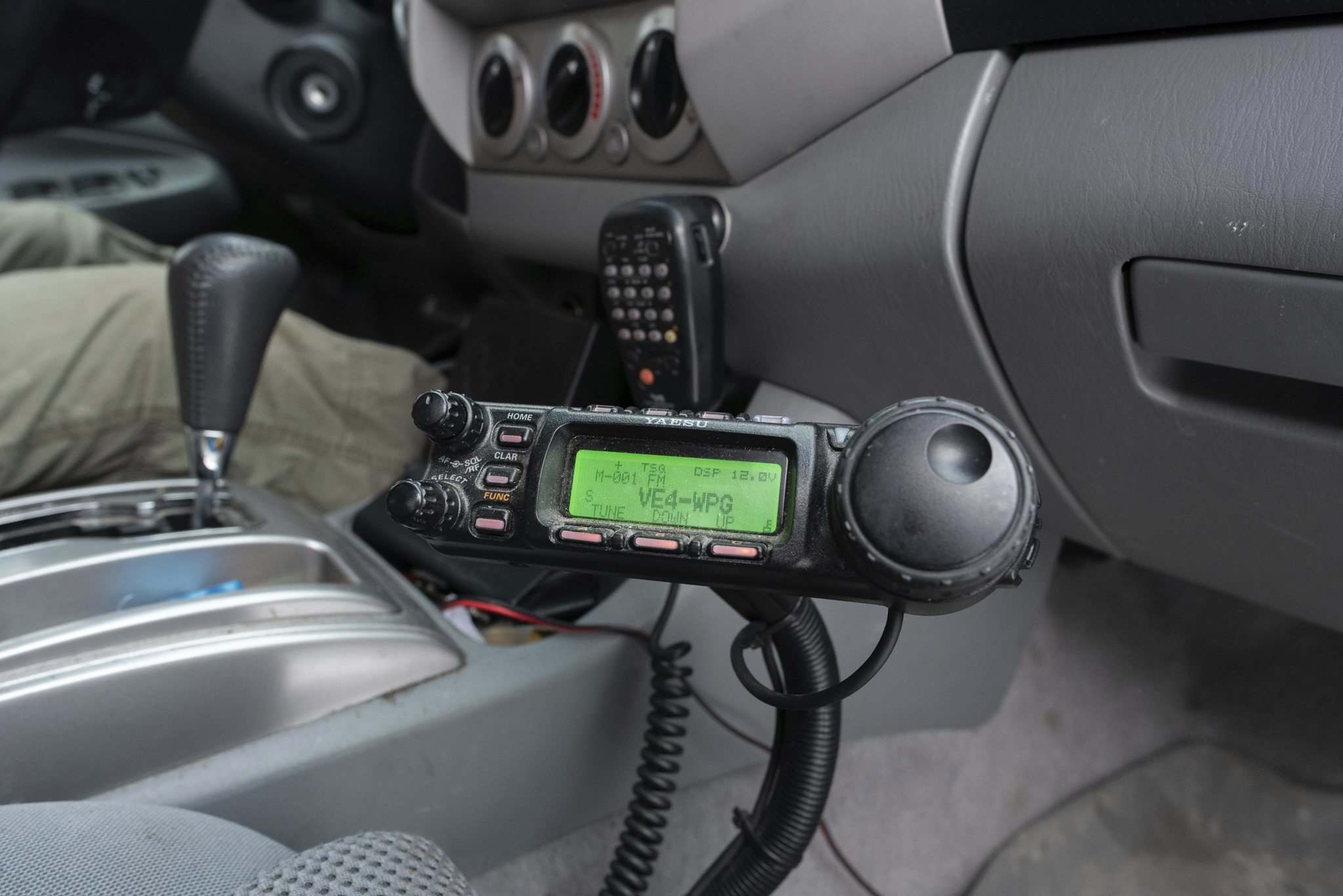 The radio in Leor Drory's truck is capable of both worldwide and local communications, which typically use different frequencies.
