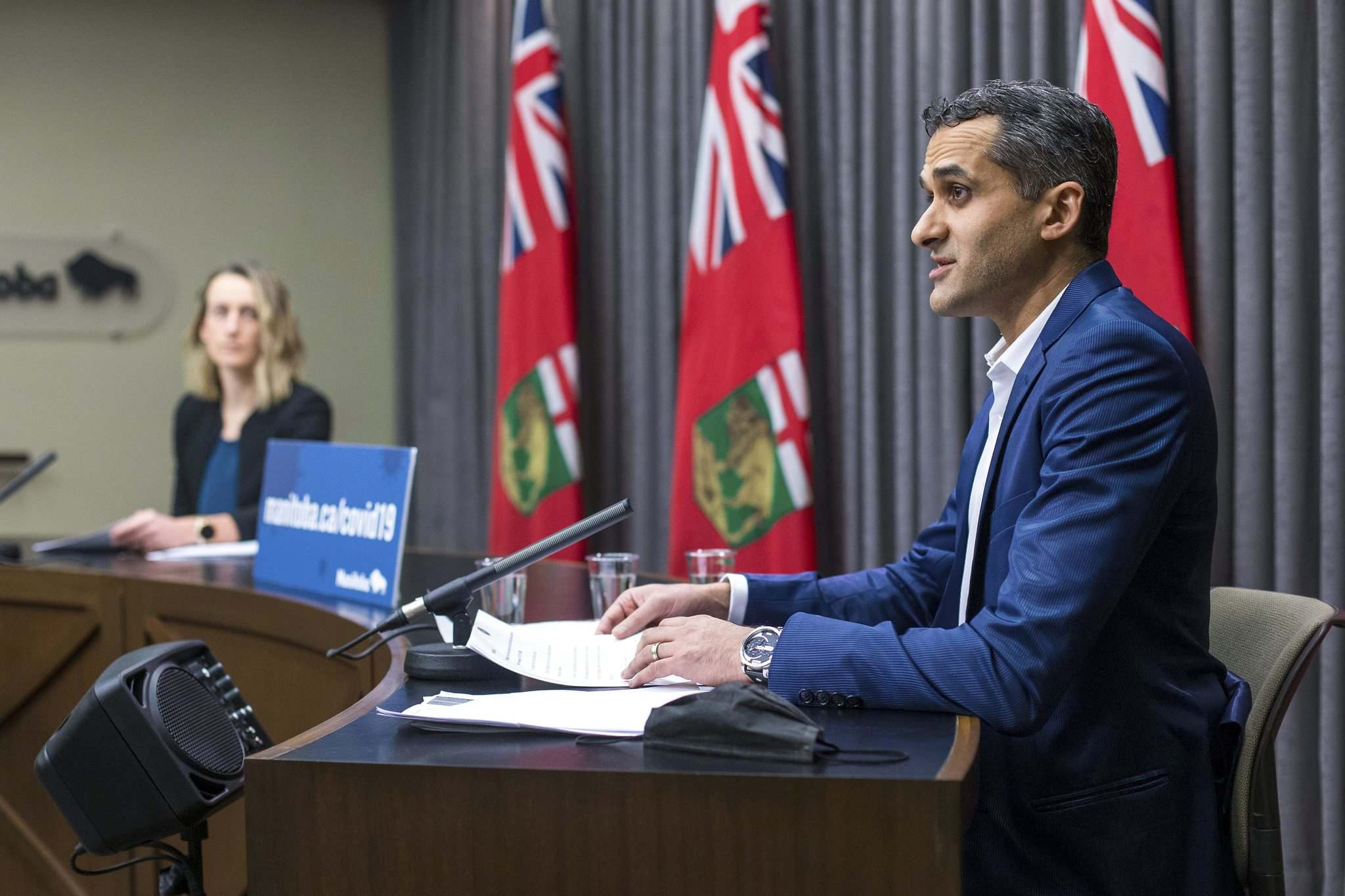"""With several hundred new cases linked to holiday gatherings and nearly 3,000 people identified as close contacts of those cases, Dr. Jazz Atwal, acting deputy chief provincial public health officer (right), said Manitobans have to buckle down for """"a little bit longer."""" (Mikaela MacKenzie / Winnipeg Free Press)"""