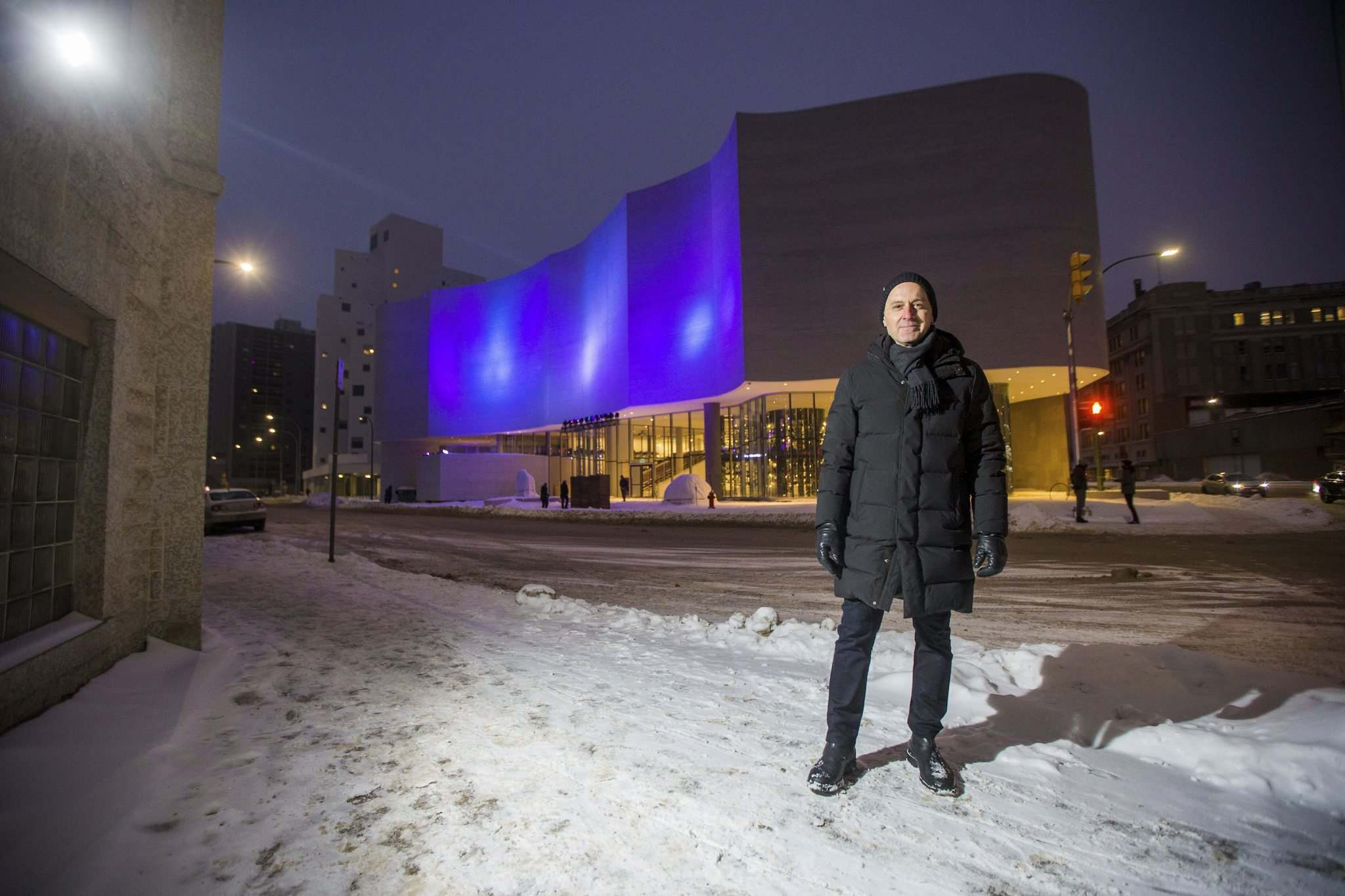 MIKAELA MACKENZIE / WINNIPEG FREE PRESS</p><p>Winnipeg Art Gallery director Stephen Borys in front of the Qaumajuq building, lit up with colours of the Northern Lights during Friday's opening of the Qaumajuq365 celebration.</p>