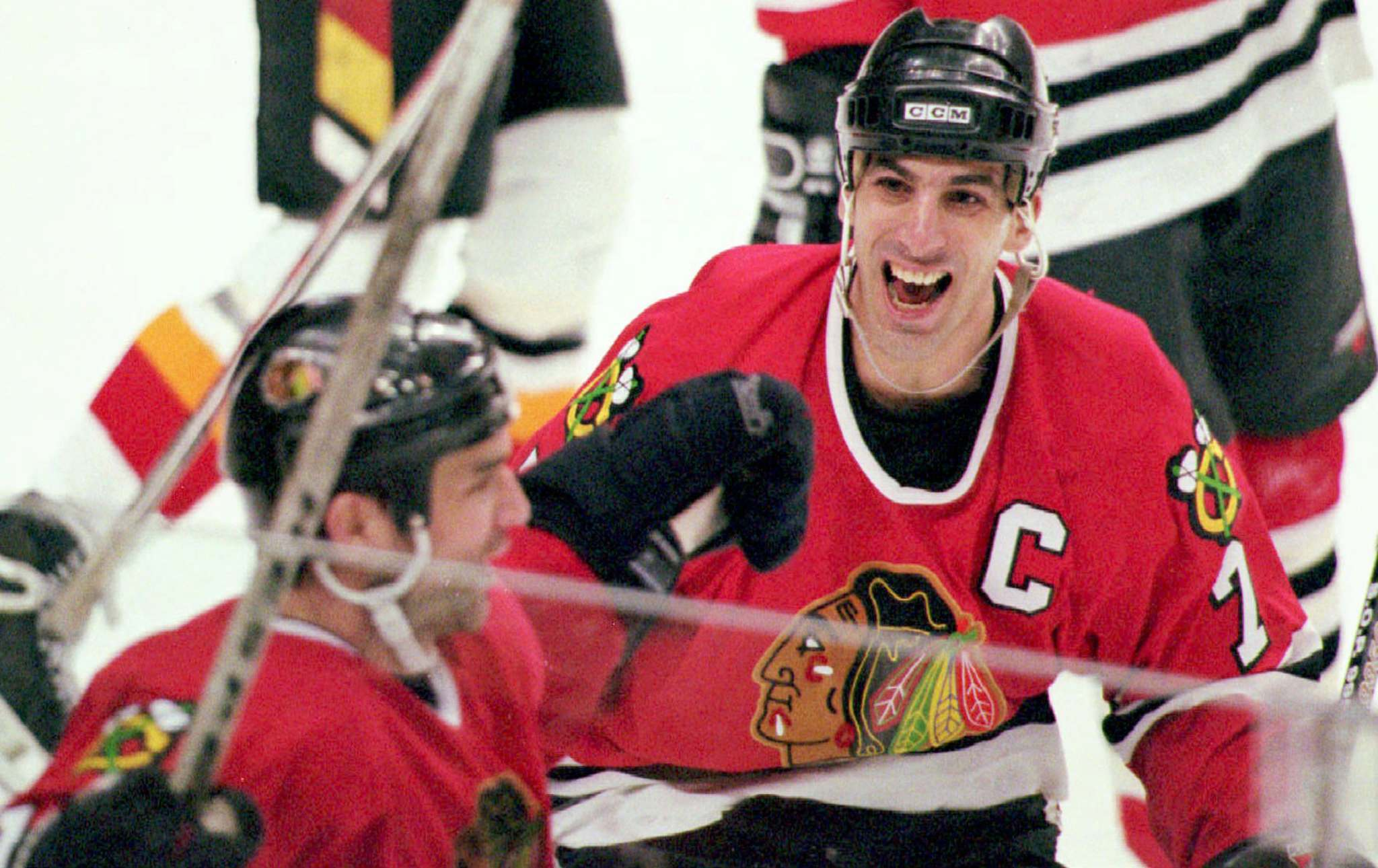 Mike Ridewood / The Canadian Press files</p><p>In this 1996 photo, Chicago Blackhawks captain Chris Chelios congratulates teammate Joe Murphy (left) after Murphy scored the game and series winning goal for the Blackhawks against the Calgary Flames.</p>