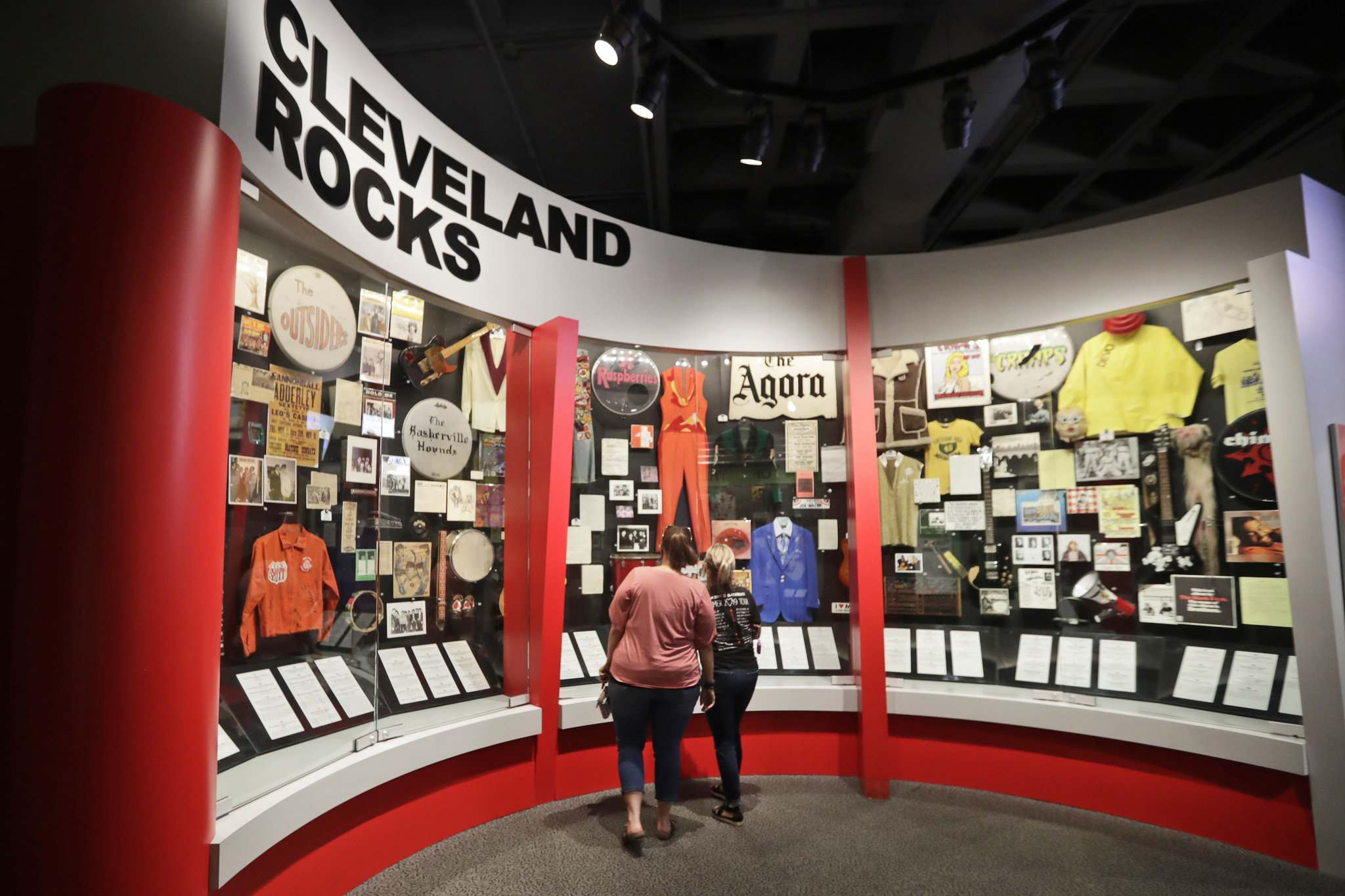 Museum visitors enjoy an exhibit at the Rock and Roll Hall of Fame in Cleveland. (Tony Dejak / The Associated Press)