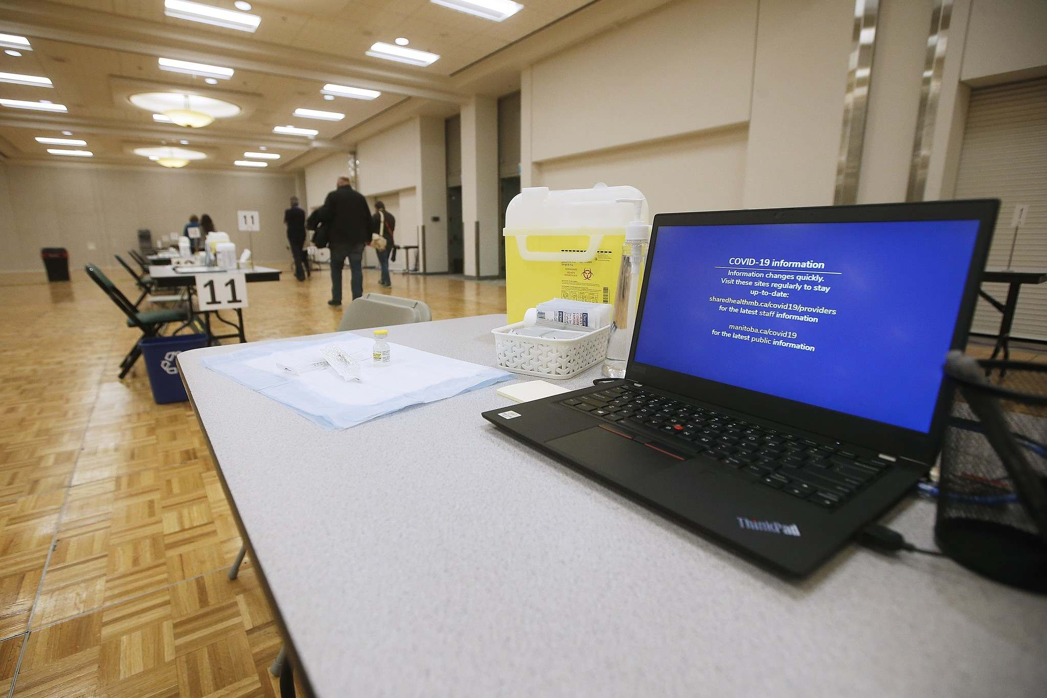 """THE CANADIAN PRESS FILES/John Woods  The province has immunized only about 800 to 900 people a day at the RBC Convention Centre """"super site"""" clinic."""