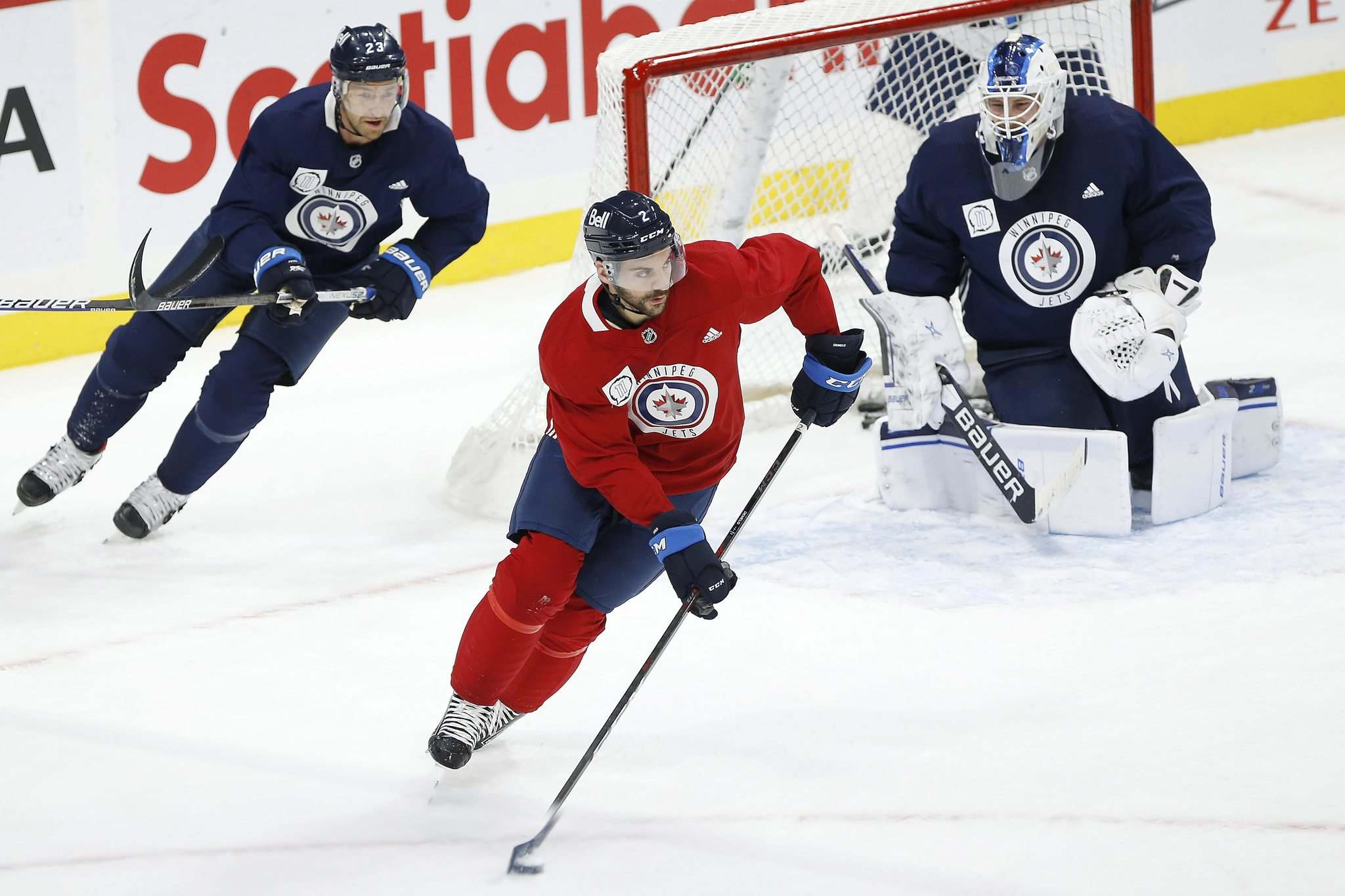 "JOHN WOODS / WINNIPEG FREE PRESS</p> <p>Winnipeg Jets' Dylan DeMelo (2) picks up a loose puck at practice Sunday. He will not make the trip, missing his second straight game to stay home and offer support for his partner as they tend to their newborn baby. </p> <p>""> </a><figcaption readability="