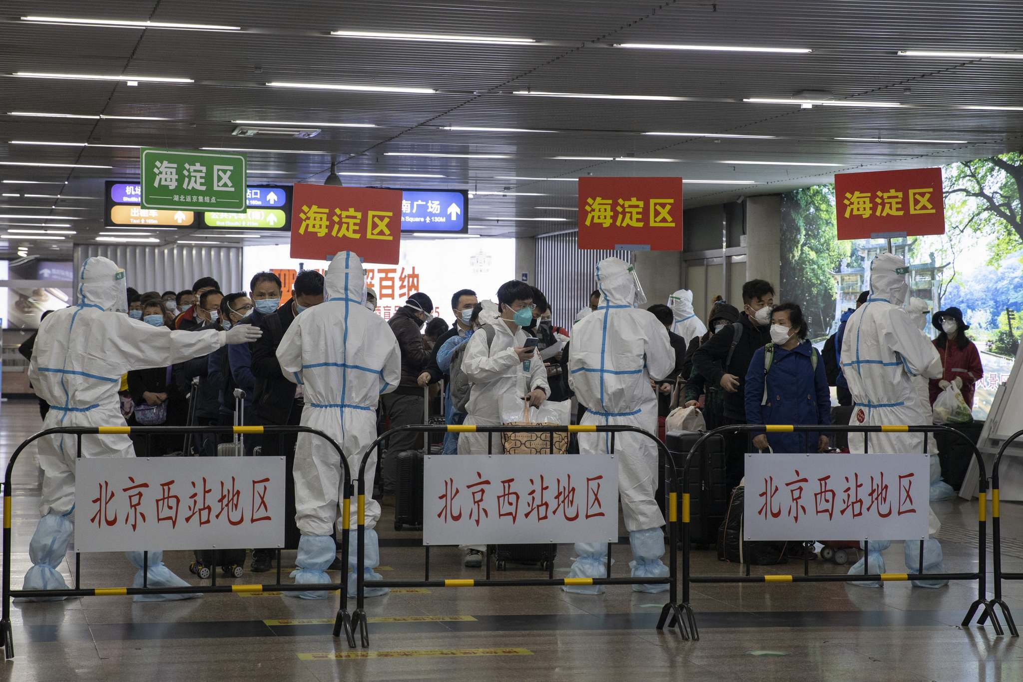 Passengers from Wuhan are sorted by district after they arrive on a high speed train in Beijing on Sunday, April 19, 2020. Wuhan, the city at the center of the global coronavirus epidemic, lifted a 76-day lockdown early April and allowed people to leave for destinations across China. (AP Photo/Ng Han Guan)</p>