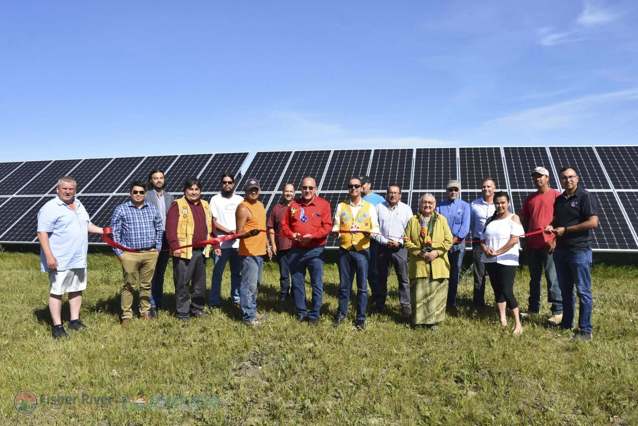 SUPPLIED</p><p>This summer, Fisher River Cree Nation unveiled the largest solar farm in the province, with excess energy sold back into Manitoba Hydro's grid. In the centre are Chief David Crate (in red) with AMC Grand Chief Arlen Dumas.</p></p>