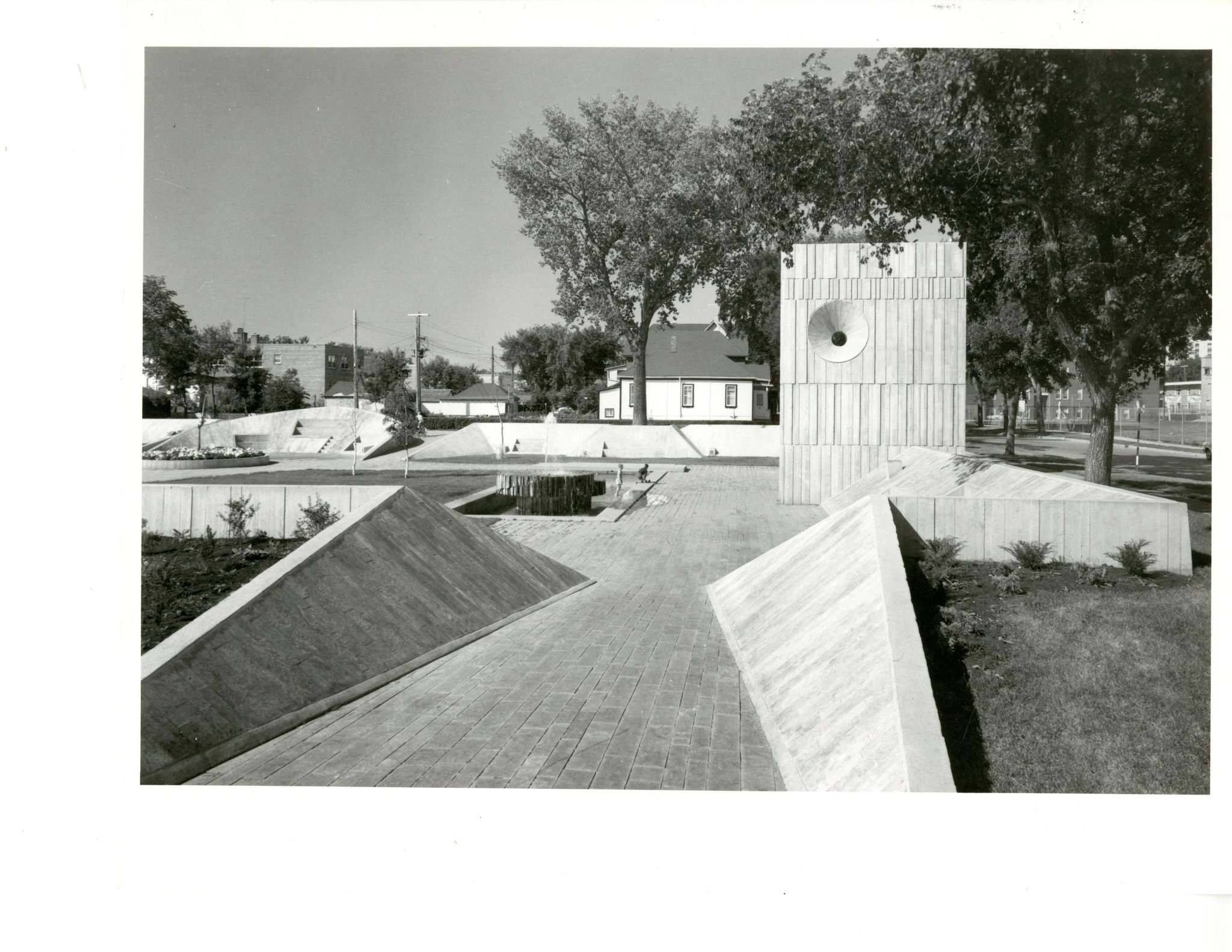 Henry Kalen / University of Manitoba Archives</p><p>Metro Plaza, designed by Étienne Gaboury and built in 1966, once stood at Confusion Corner. All but the perimeter wall and the taller portion of the structure were razed by the city in 1987. </p>