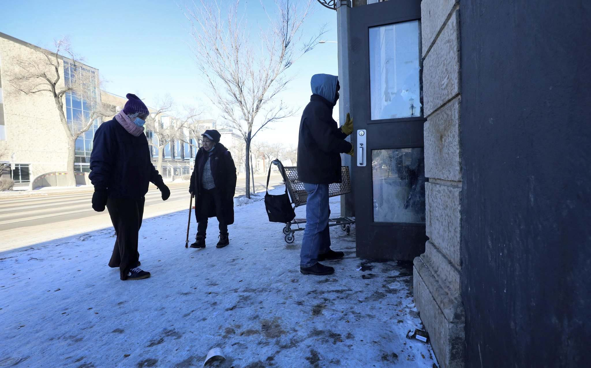People seek shelter at Main Street Project from the extreme cold temperatures Tuesday.