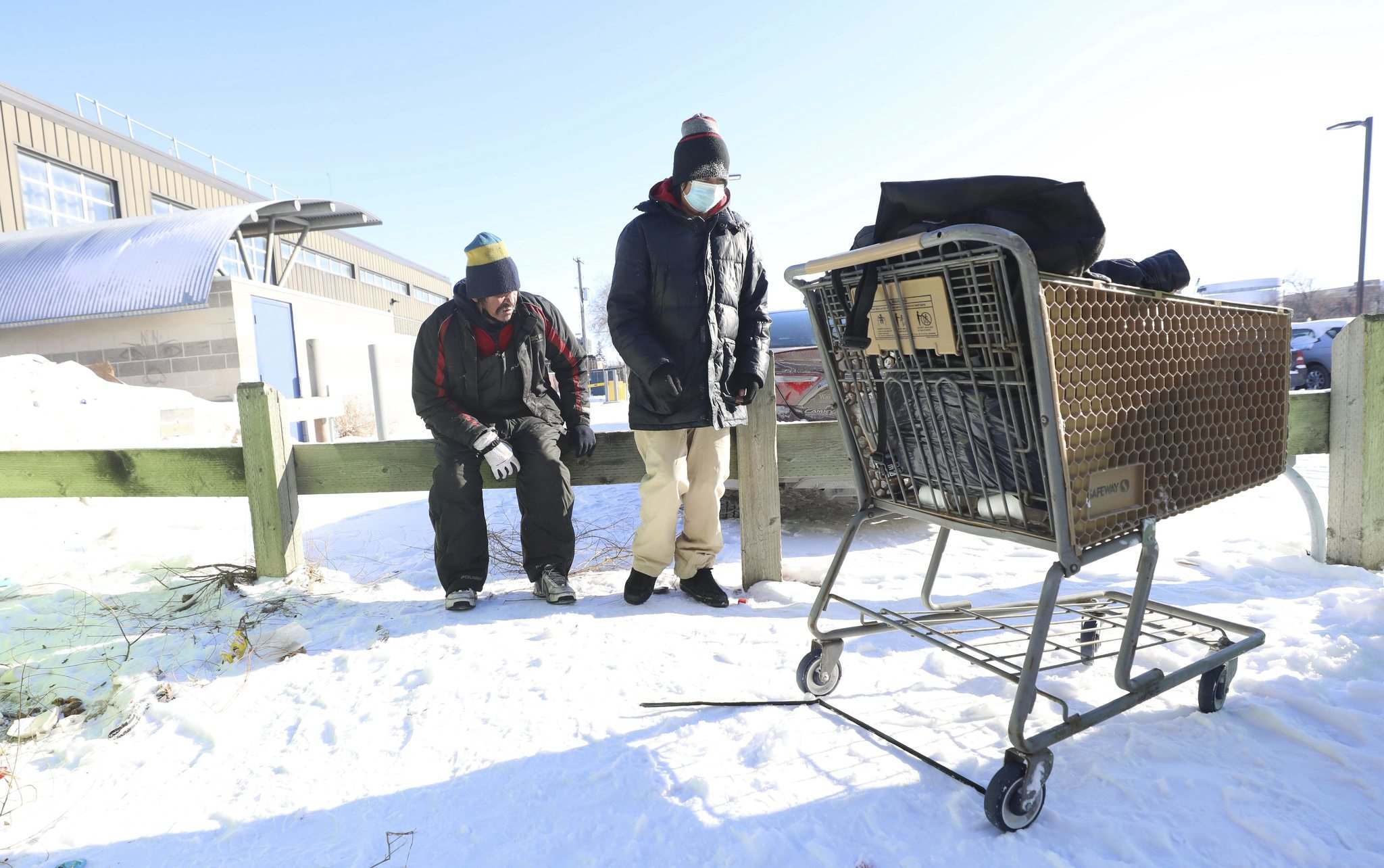 Winston Yellowback (right) and his friend Peter Blackhawk make their way back to Main Street Project shelter on Tuesday.