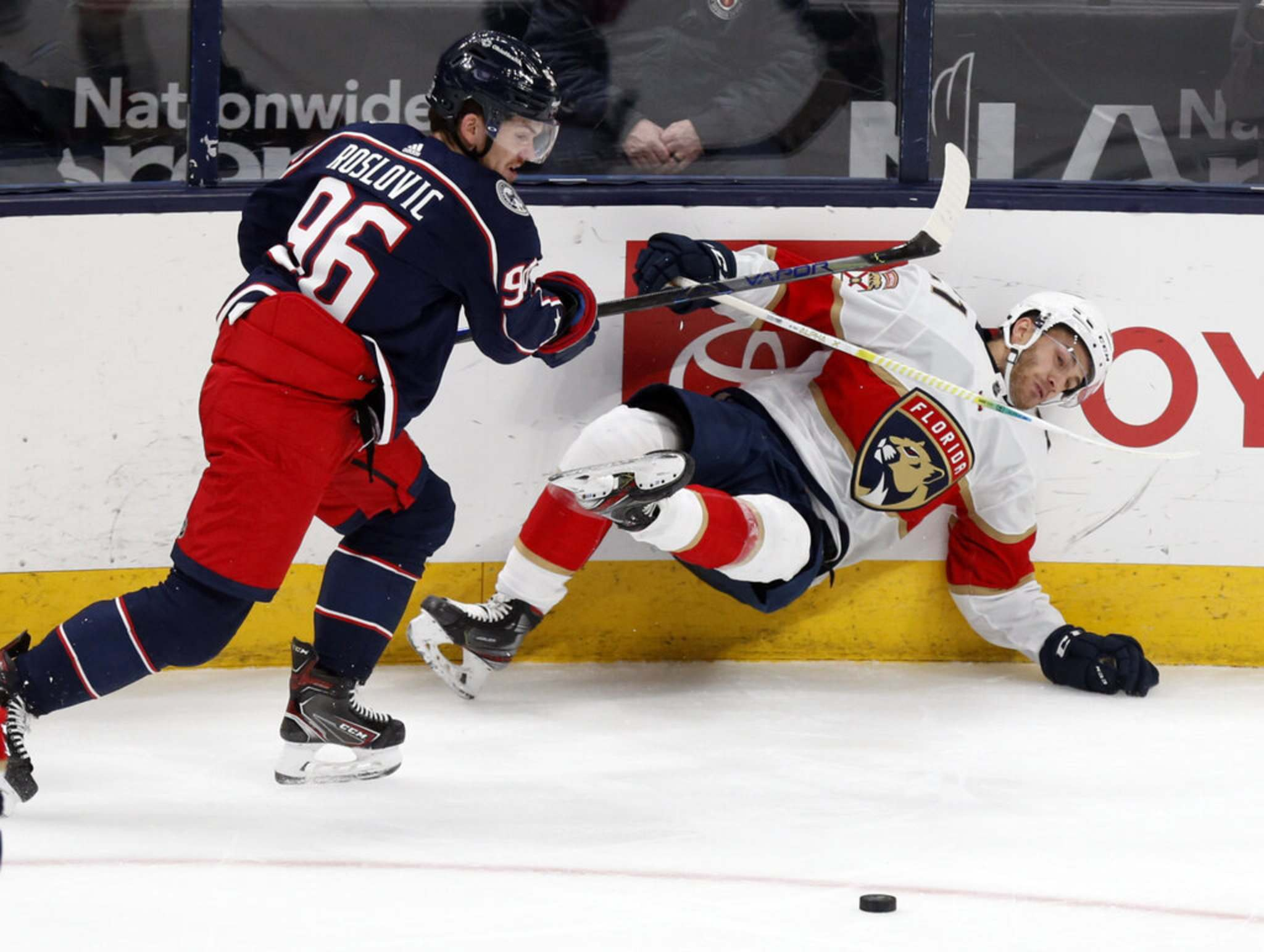 Jack Roslovic, left, has already played four games for the Columbus Blue Jackets since his trade from the Winnipeg Jets. (AP Photo/Paul Vernon)</p>