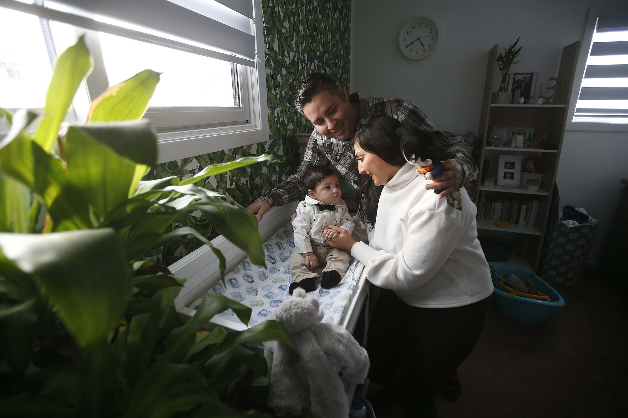 The birth of Louie helped Andrea Tiwari, with fiancé Nelson Salazar, cope with the loss of her father. (John Woods / Winnipeg Free Press)</p>