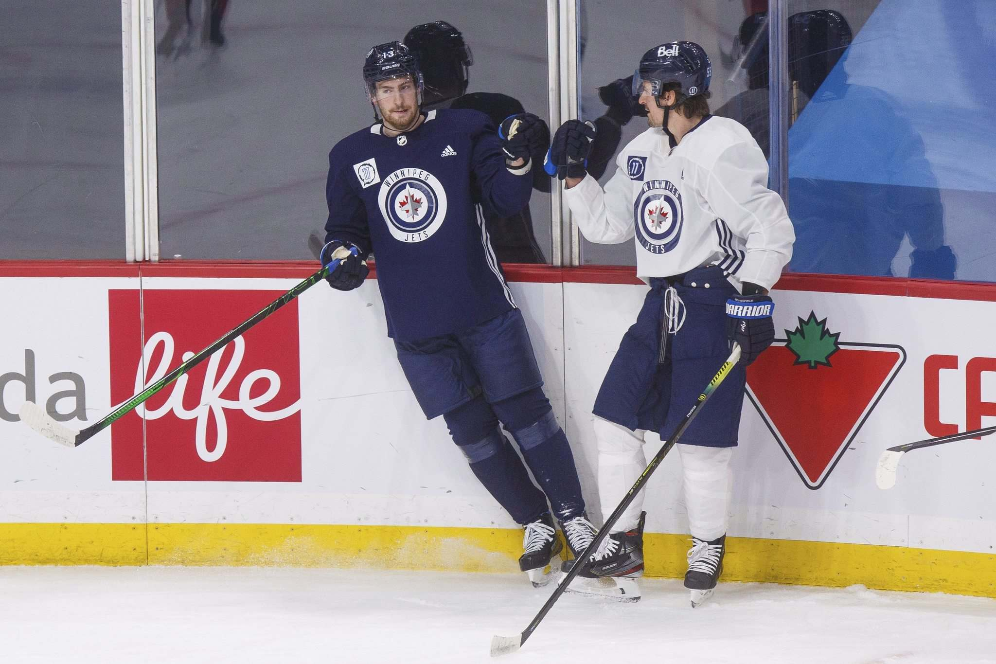 Dubois (left), the third-overall pick in the 2016 NHL draft, has 66 goals, 93 assists and 159 points in his first 239 NHL games. Mark Scheifele (right), the seventh-overall pick in the 2011 NHL draft, had 64 goals, 93 assists and 157 points in his first 239 NHL games.