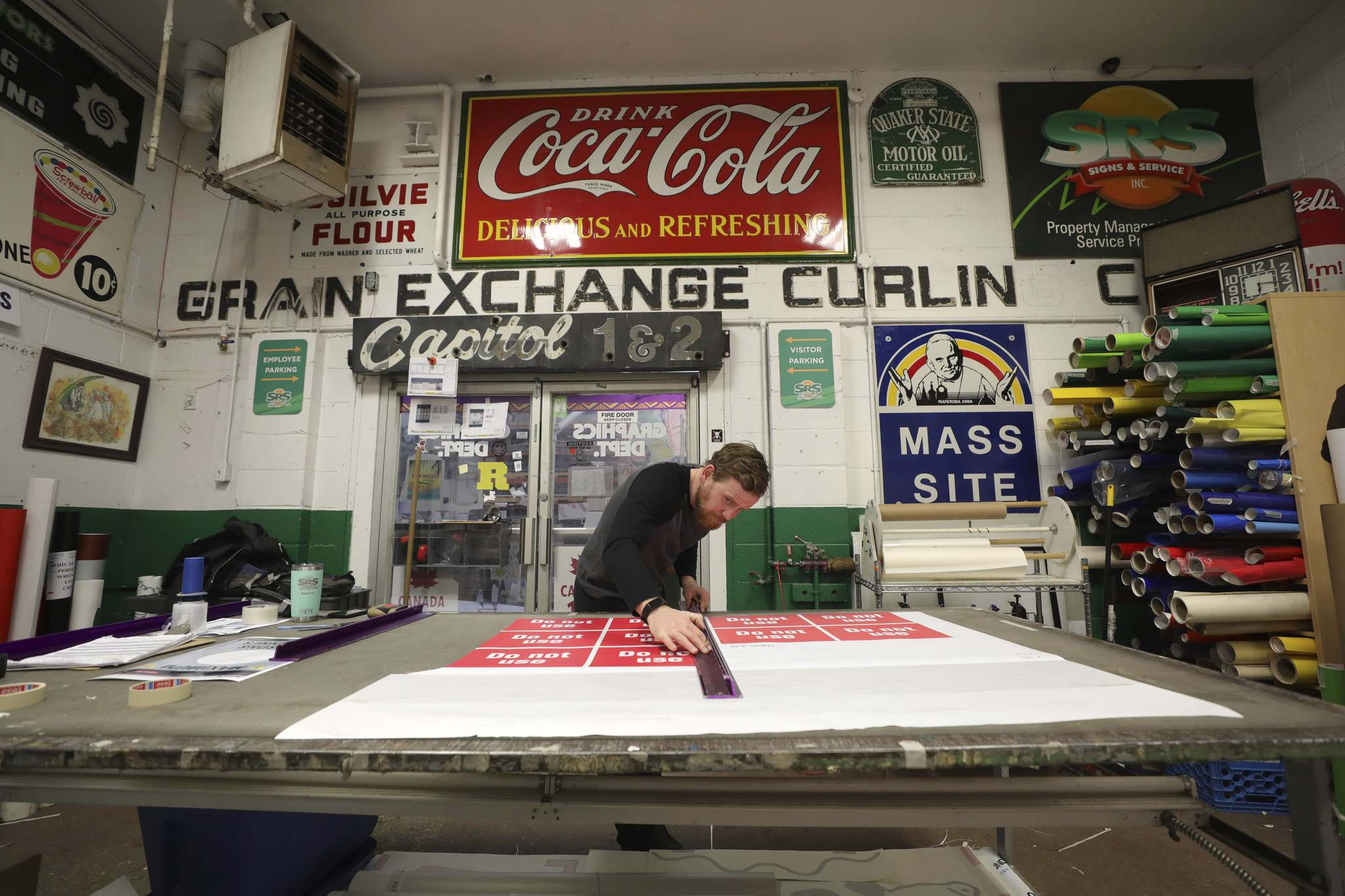 Storie says his employees, while making a new sign for a business take inspiration from the artifacts around them.