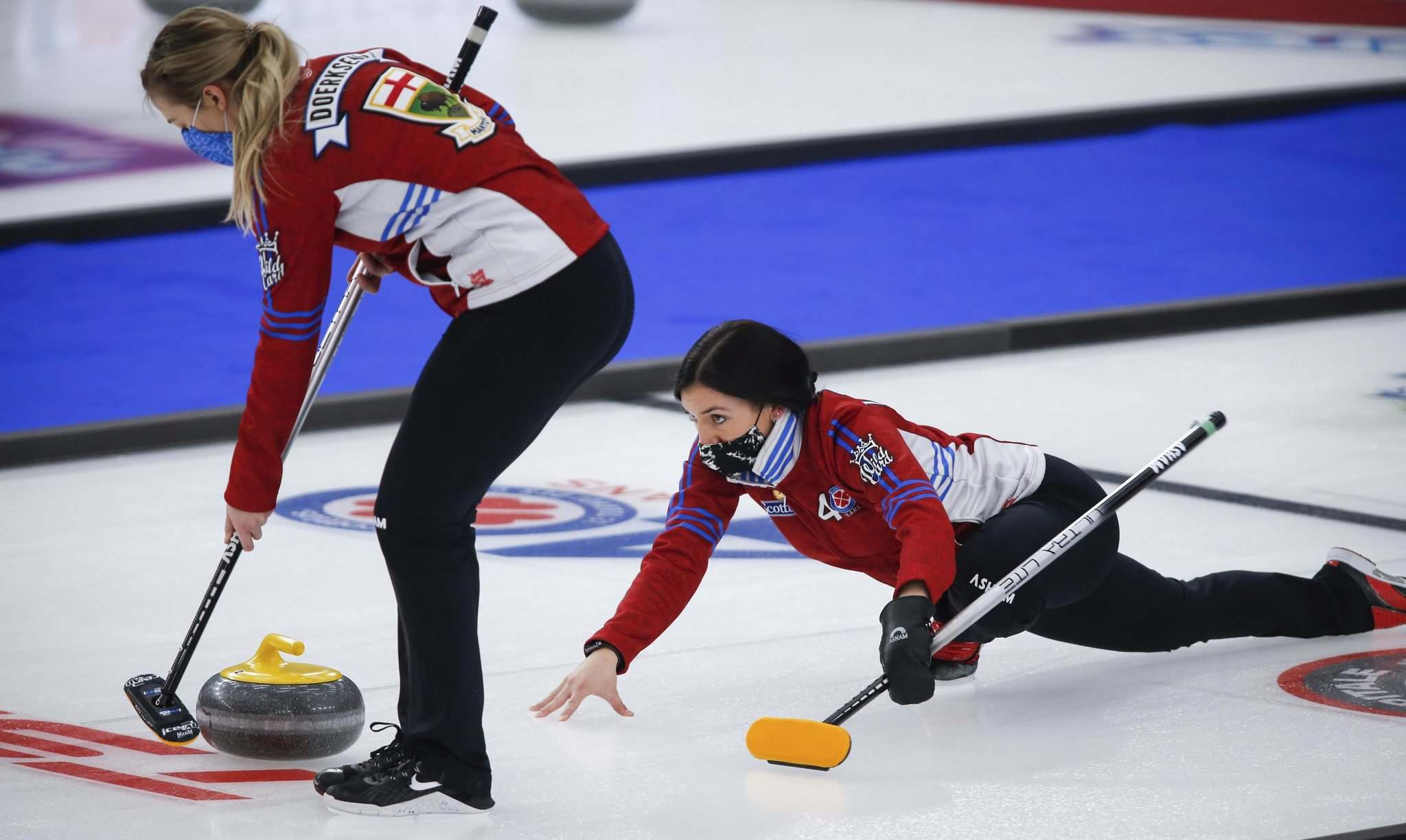 Jeff McIntosh / The Canadian Press</p><p>Second Katherine Doerksen applies the brush while skip Beth Peterson releases a shot during a practice session at the Scotties Tournament of Hearts in Calgary on Thursday.</p></p>