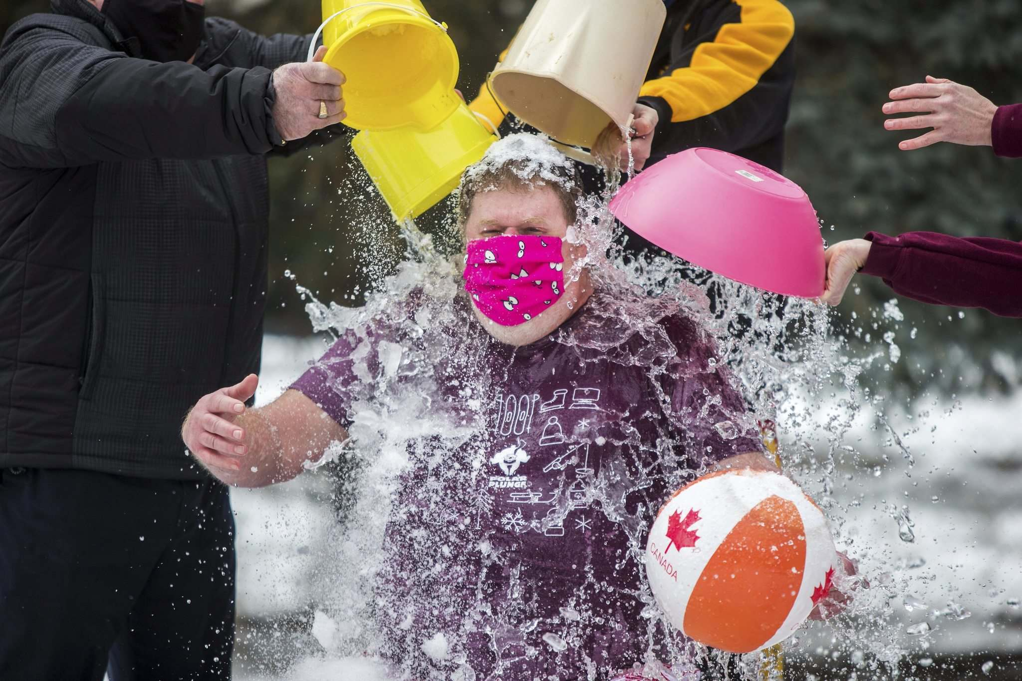 MIKAELA MACKENZIE / WINNIPEG FREE PRESS</p><p>Doug Speirs gets ice, water, and snow dumped on him by Special Olympics Manitoba fundraising manager Terry Hopkinson (left), Special Olympics Manitoba athlete Adam Lloyd, and CEO of Special Olympics Manitoba Jennifer Campbell as part of the Virtual Polar Plunge in his backyard in Winnipeg on Wednesday, Feb. 24, 2021. For Doug story.</p><p>Winnipeg Free Press 2021</p>