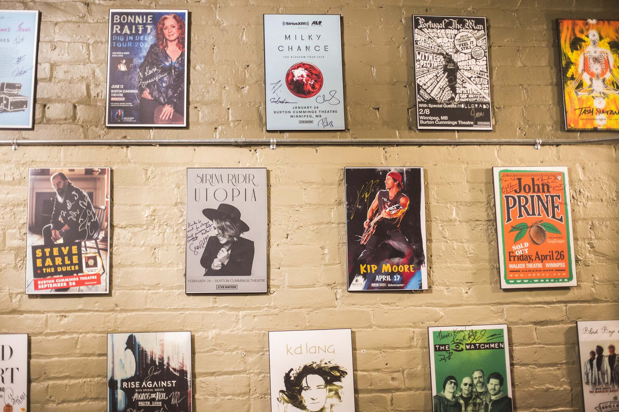 Signed posters from past shows in the green room. (Mikaela MacKenzie / Winnipeg Free Press)</p>