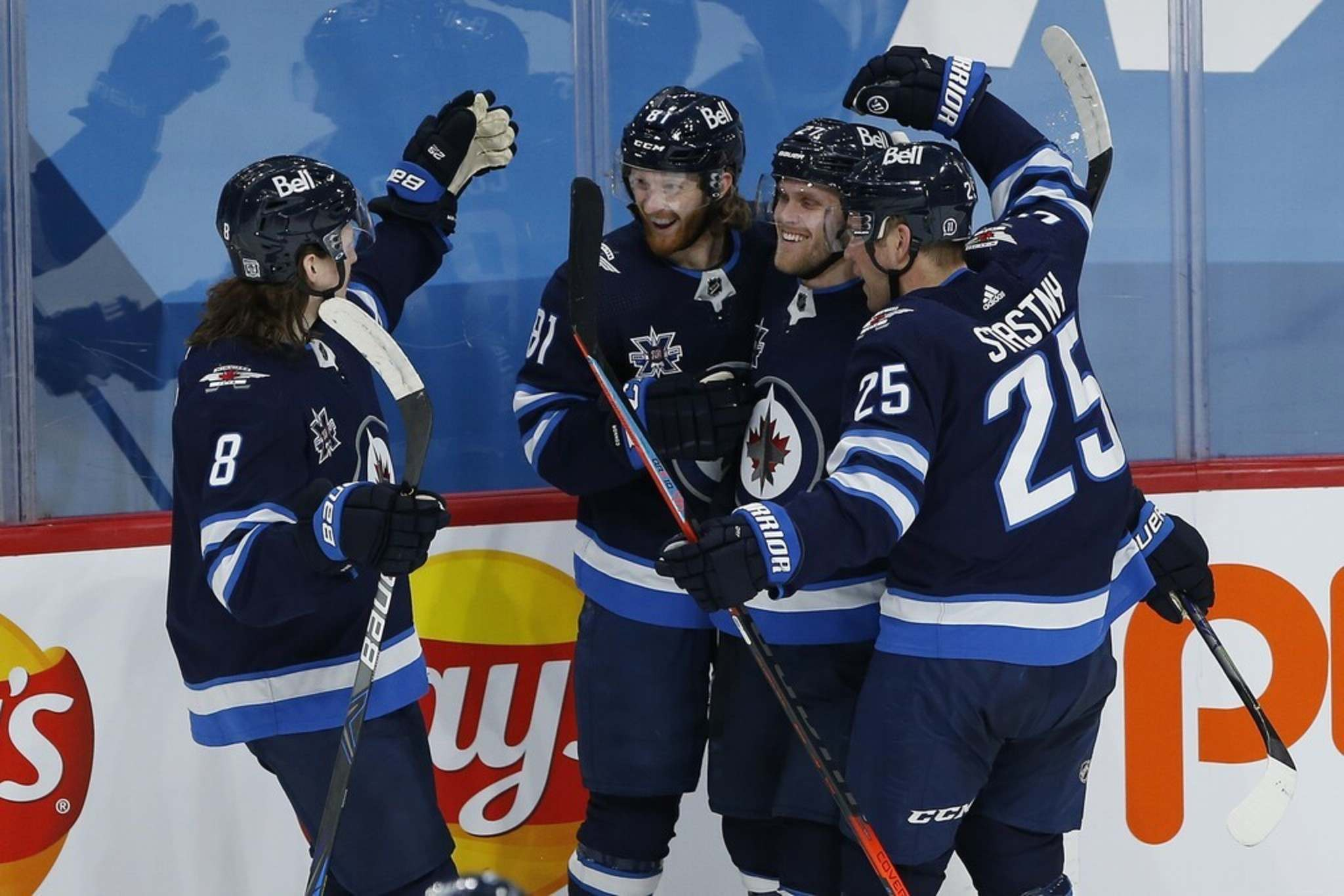 Winnipeg Jets' players celebrate Kyle Connor's goal against the Montreal Canadiens on February 25. Despite the second-best record in the NHL's North division at 14-7-1, the Jets' underlying numbers suggest tougher times await the club. THE CANADIAN PRESS/John Woods</p>