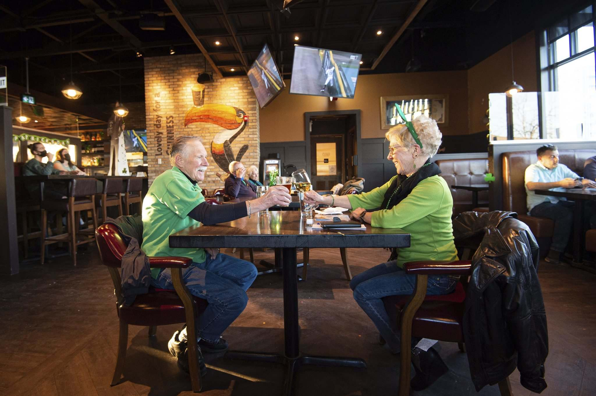 MIKE SUDOMA / WINNIPEG FREE PRESS </p><p>Don and Ethel McCully enjoy some time away from home as they celebrate St. Patrick's Day together at Fionn MacCool's on Grant Avenue Wednesday.</p>