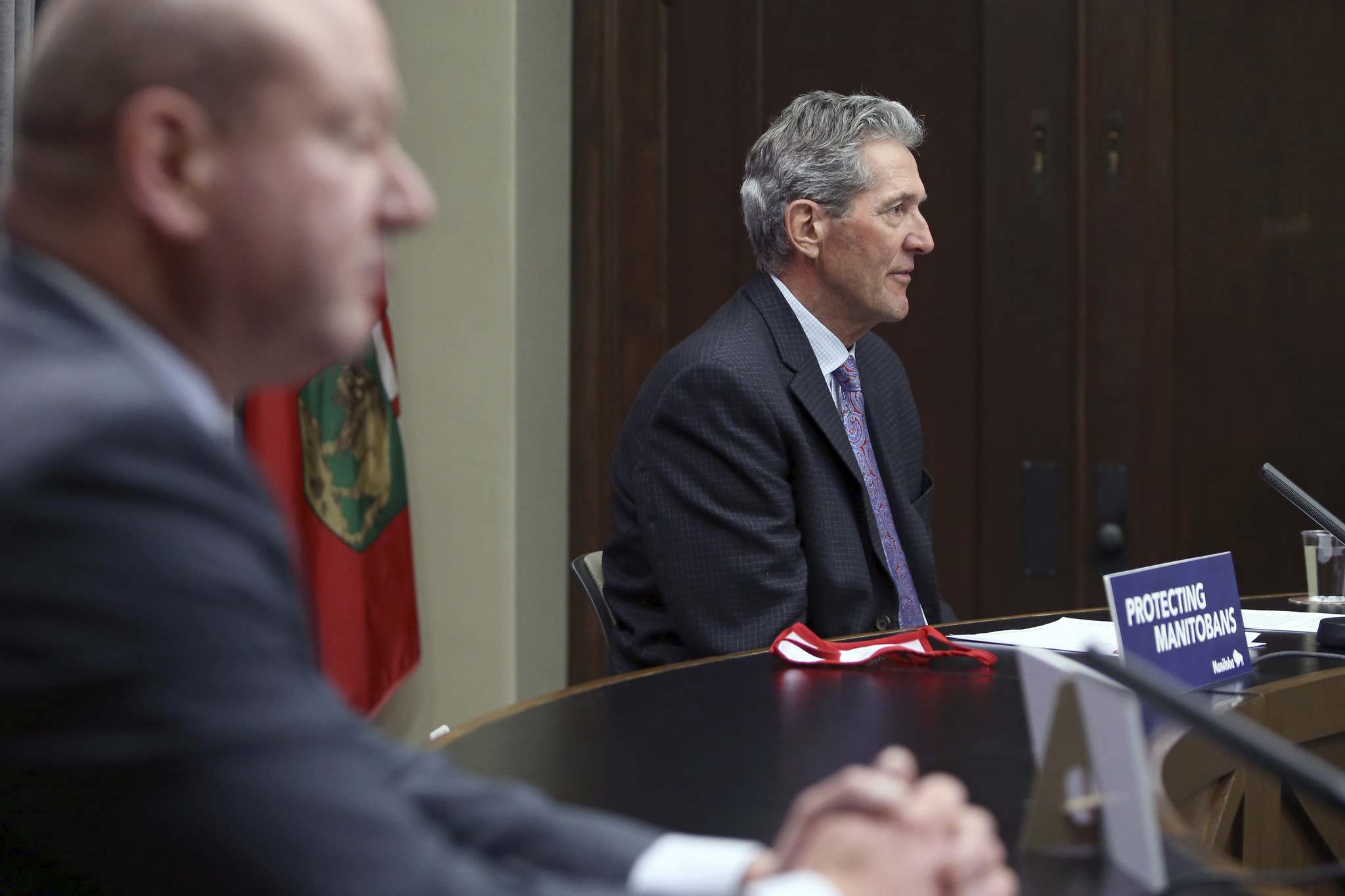 """""""These changes… are cautious changes, and they are designed to help us move in the direction of protecting and safeguarding the well-being of Manitobans, in all respects,"""" said Premier Brian Pallister. (Kevin King / Pool)"""