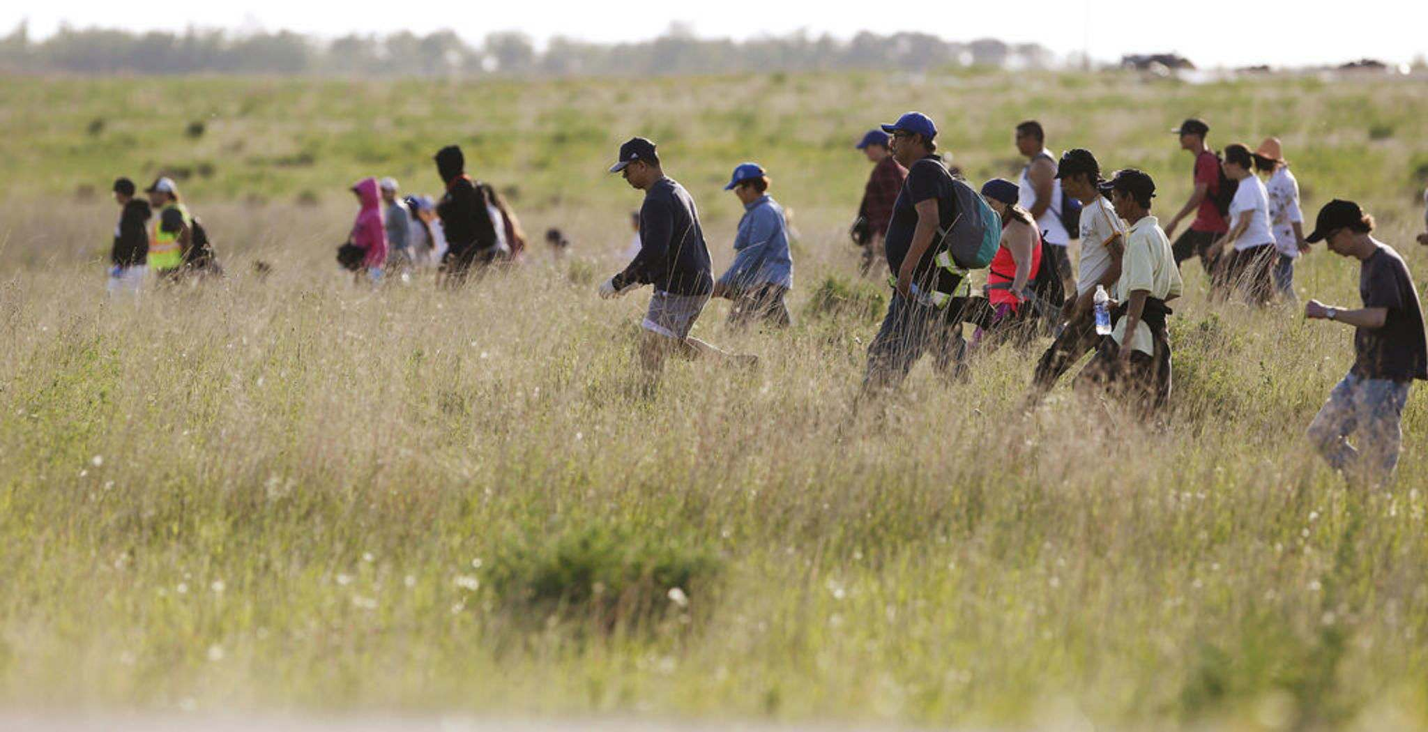 JOHN WOODS / WINNIPEG FREE PRESS FILES</p><p>Volunteers searched for Eduardo Balaquit in a field just outside the perimeter highway in Winnipeg shortly after his disappearance.</p>