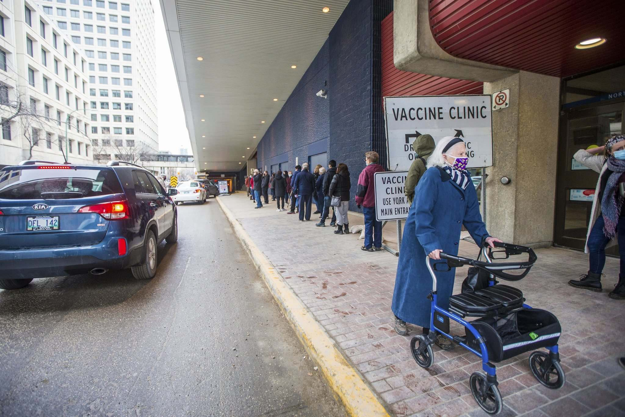 All the wheelchairs on site were being used so seniors would have a place to sit down while waiting for hours in line. (Mikaela MacKenzie / Winnipeg Free Press)