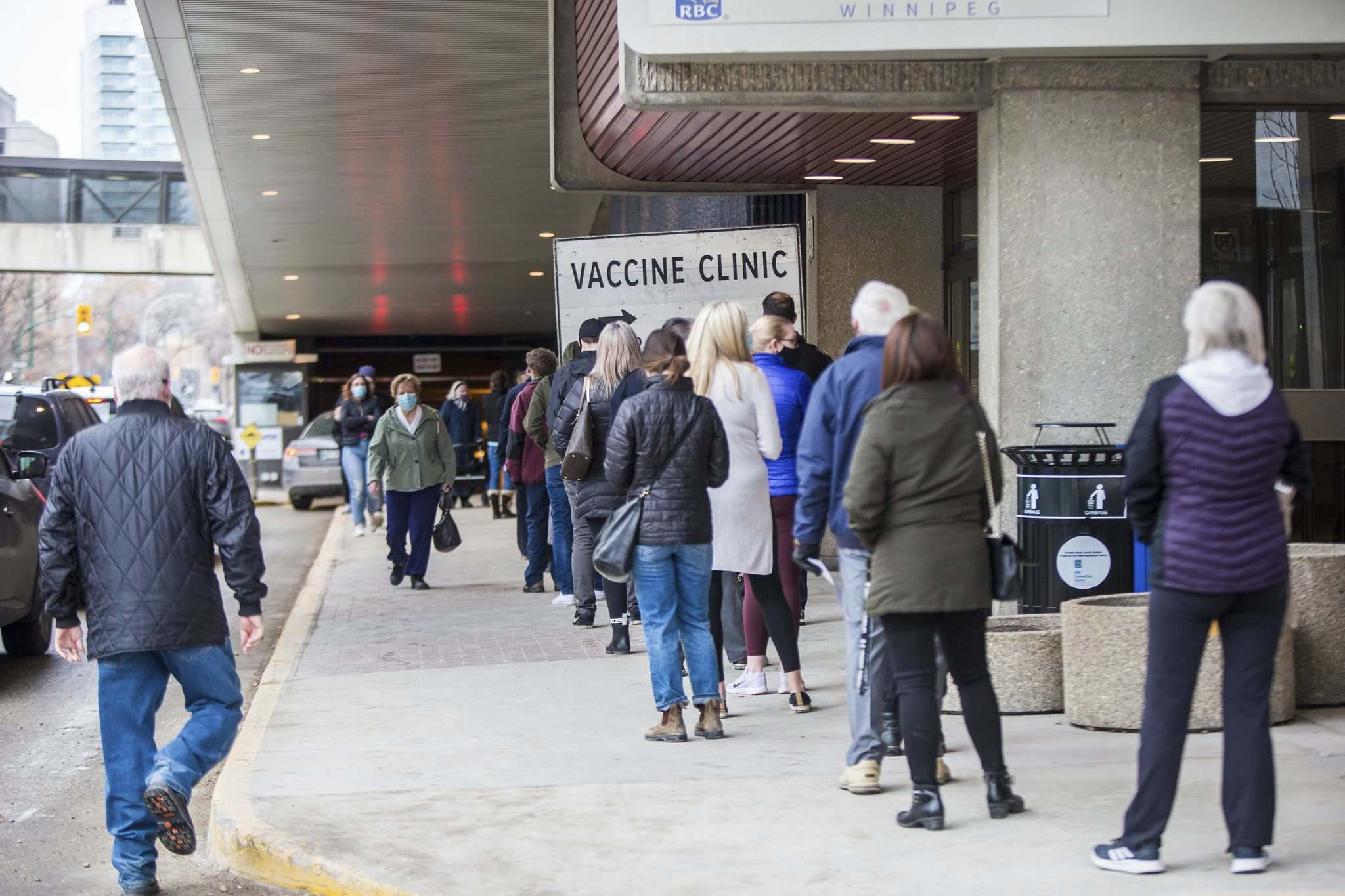 A line snaked outside the convention centre Friday afternoon because of a computer glitch that affected staffing. (Mikaela MacKenzie / Winnipeg Free Press)