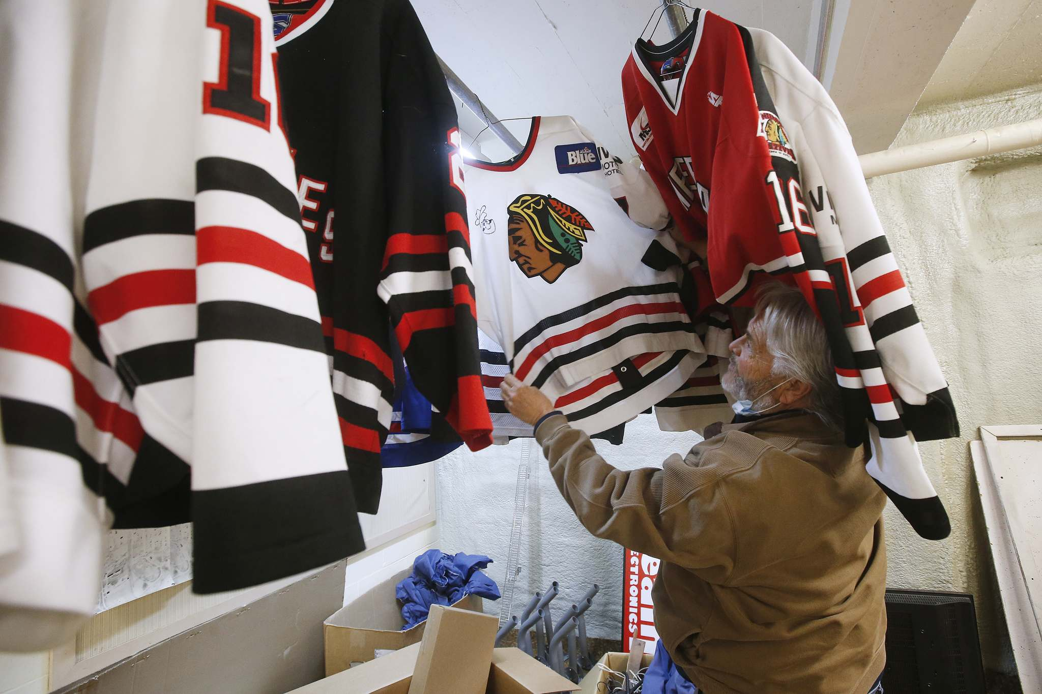 JOHN WOODS / WINNIPEG FREE PRESS</p><p>Dave McIntosh, a business owner in Neepawa, looks through his Neepawa Natives jersey collection. McIntosh was a driving force behind the Neepawa Natives organization for years. </p>