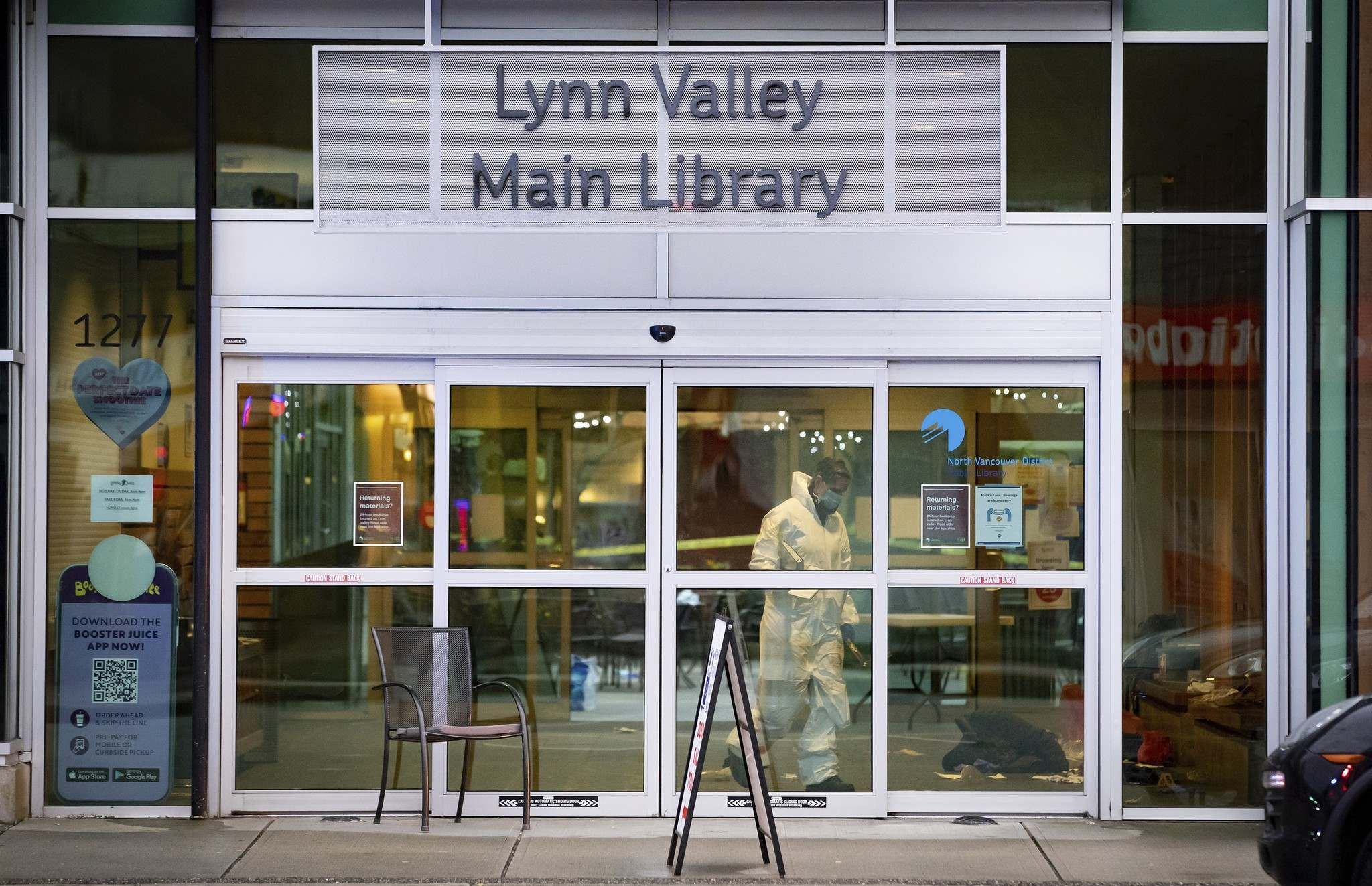A forensics police officer works inside the Lynn Valley Library in North Vancouver, B.C., Saturday.