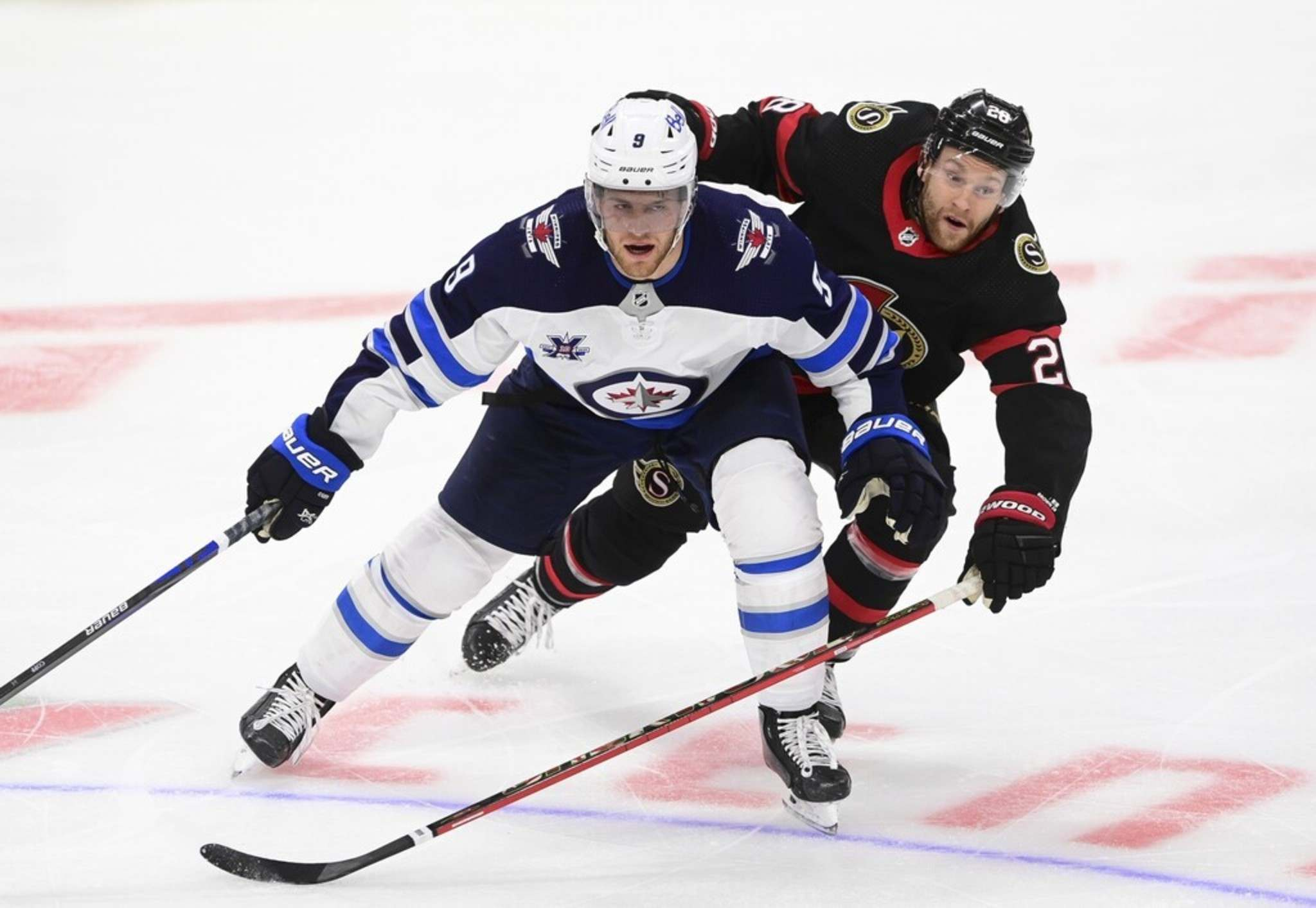 Winnipeg Jets' Andrew Copp, foreground, is having a career season where he's eclipsed personal bests in goals, assists and points. THE CANADIAN PRESS FILES/Sean Kilpatrick</p>