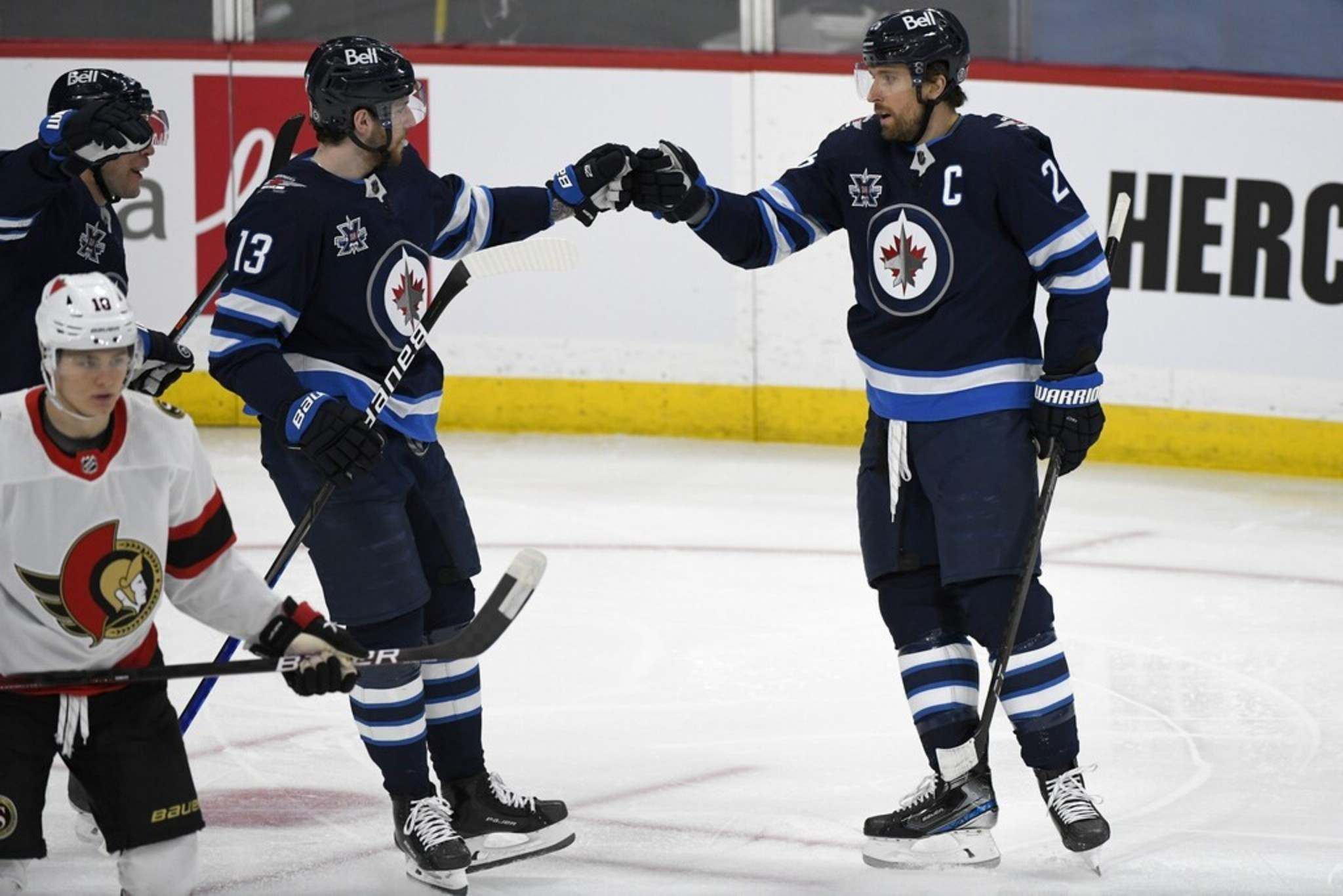 Winnipeg Jets' Pierre-Luc Dubois celebrates a goal against the Ottawa Senators with Blake Wheeler on Monday. Because Dubois is the youngest player on the Jets roster, it makes sense to have the calming presence of team captain Blake Wheeler on his wing. THE CANADIAN PRESS/Fred Greenslade</p>