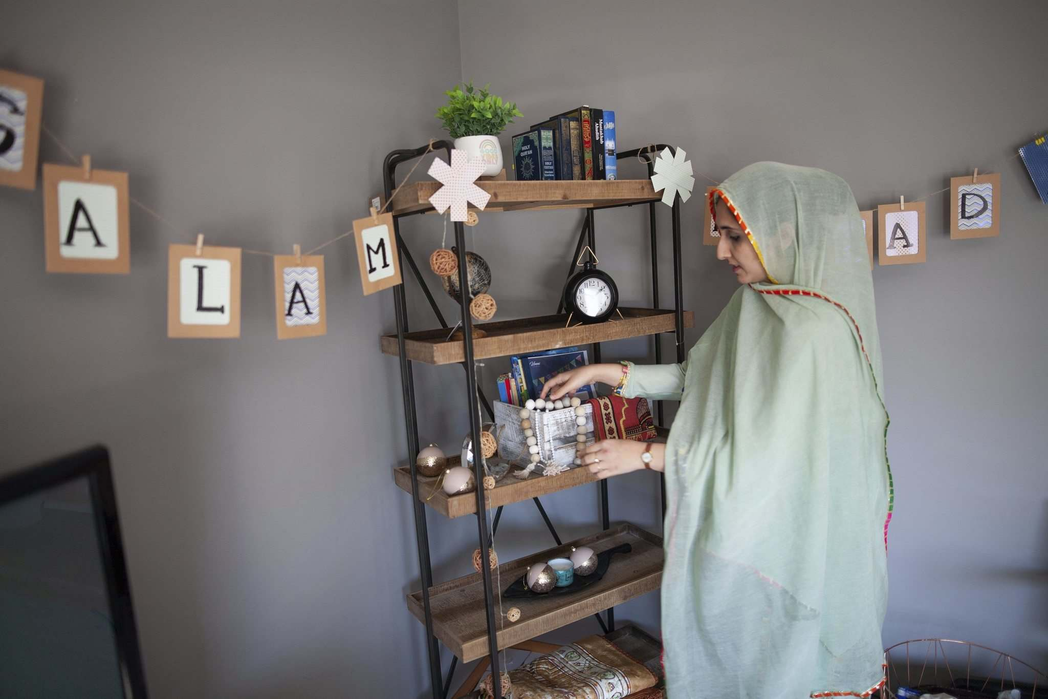 Waleed adjusts the ramadan corner her family setup in their home.