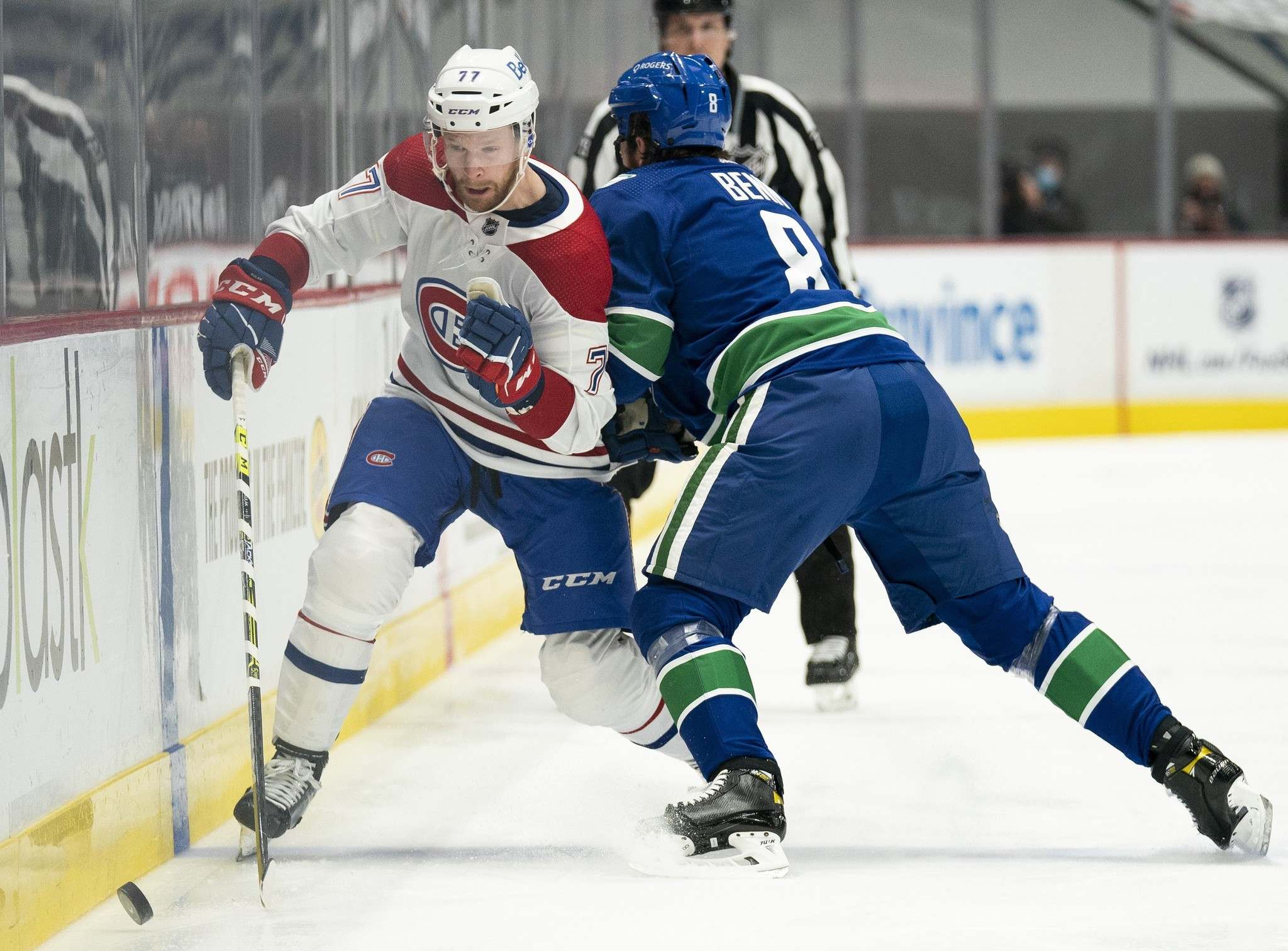 Montreal Canadiens defenceman Brett Kulak is checked by Vancouver Canucks defenceman Jordie Benn during a game in Vancouver last month.