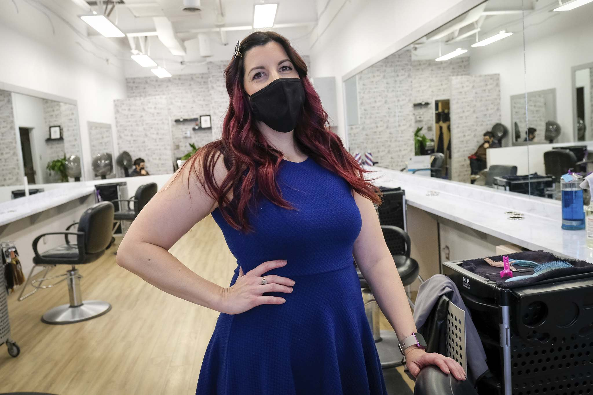 Sabrina Cornwell , a hairdresser at Hairplay Salon on Ness Avenue, is concerned about being asked to shut down her business for a third time. (Daniel Crump / Winnipeg Free Press files)