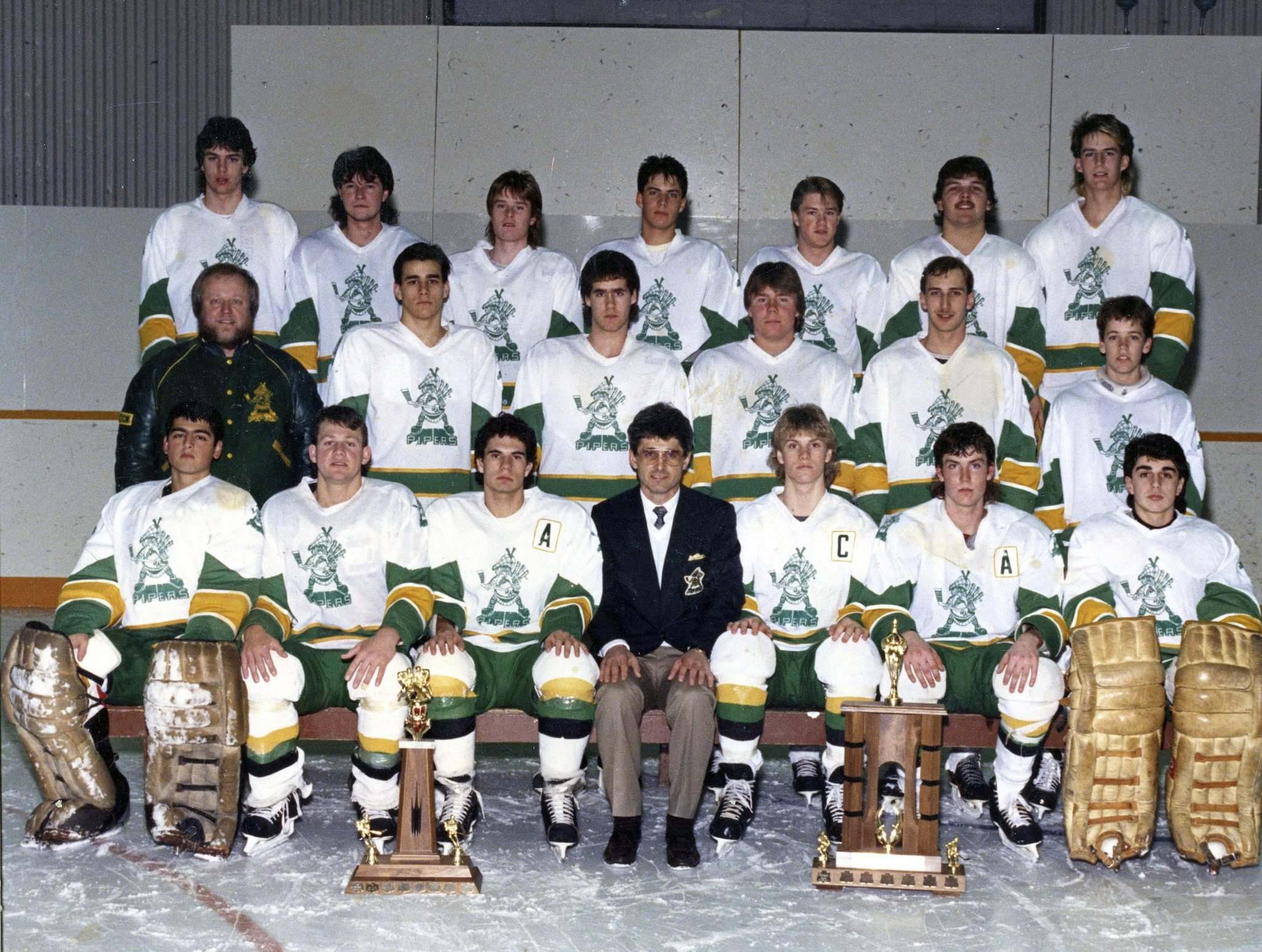 SUPPLIED</p><p>One of Jay Macaulay's happiest hockey moments occurred when the John Taylor Pipers won the high school championship in 1988. Right of Tom Trosky (centre) is Macaulay, the team's captain.</p>