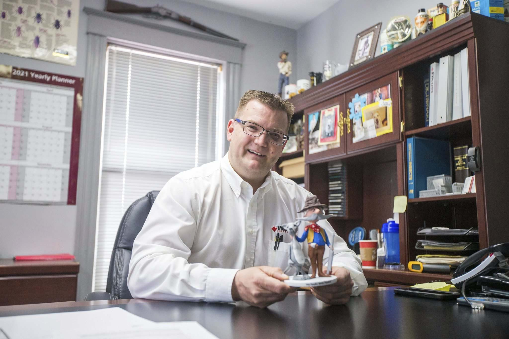 Lincoln Poulin, president of Poulin's Pest Control, took over control of the firm's day-to-day operations in 2016. His office is home to a colourful assortment of pest memorabilia. (Mikaela MacKenzie / Winnipeg Free Press)</p>