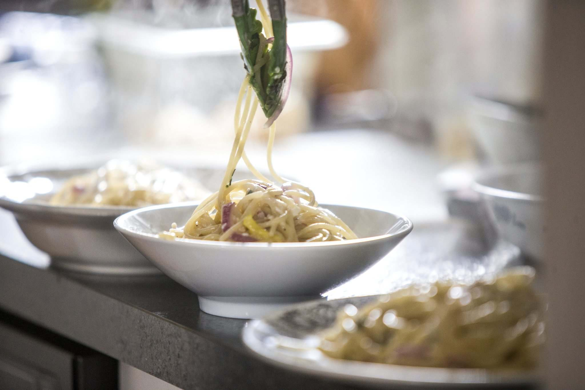Hebel puts a finishing touch on her Pasta Aglio et olio with Gamberi.</p>