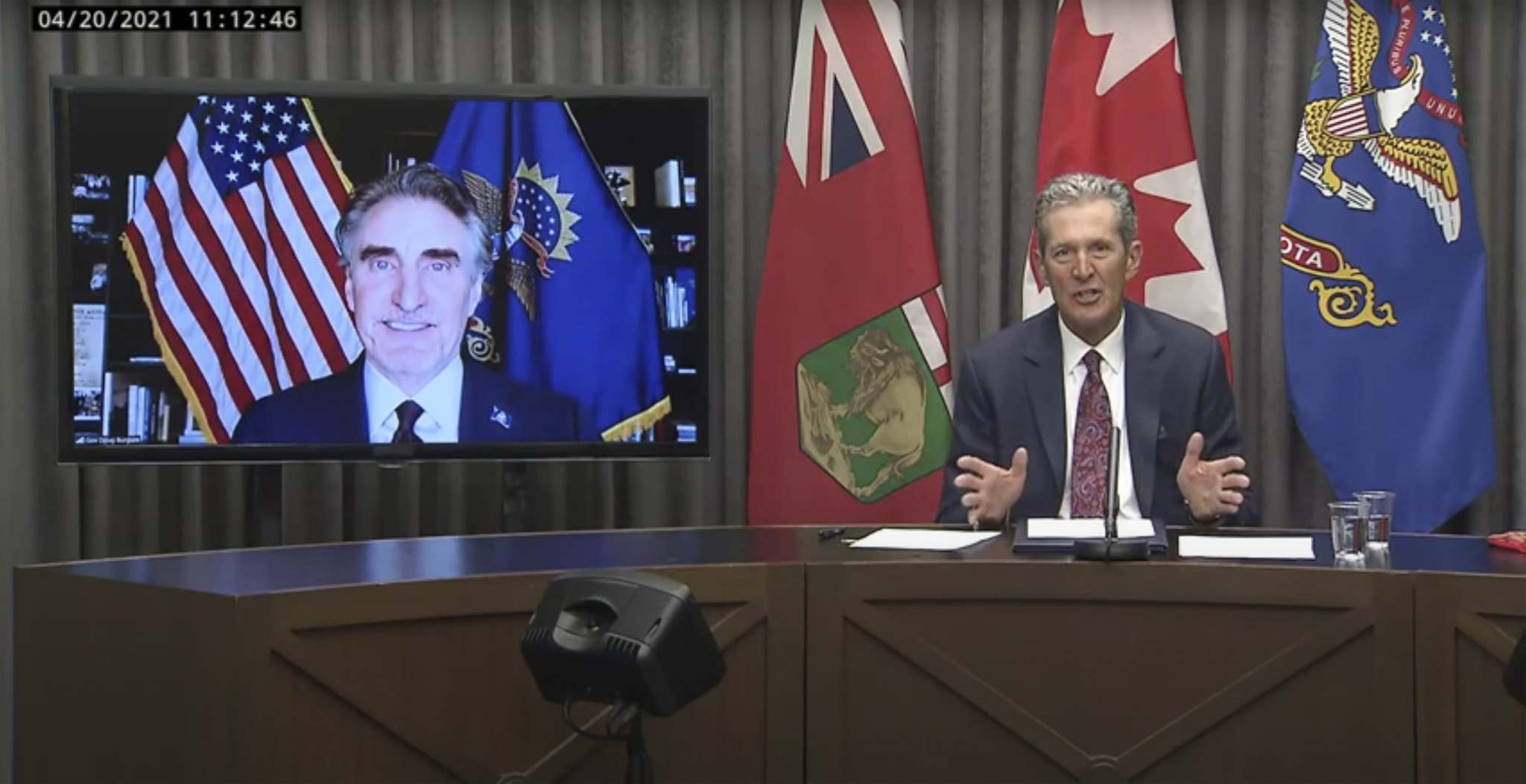 In the screenshot from a video, Premier Brian Pallister (right) was in a joint news conference with North Dakota Gov. Doug Burgum Tuesday.</p></p>