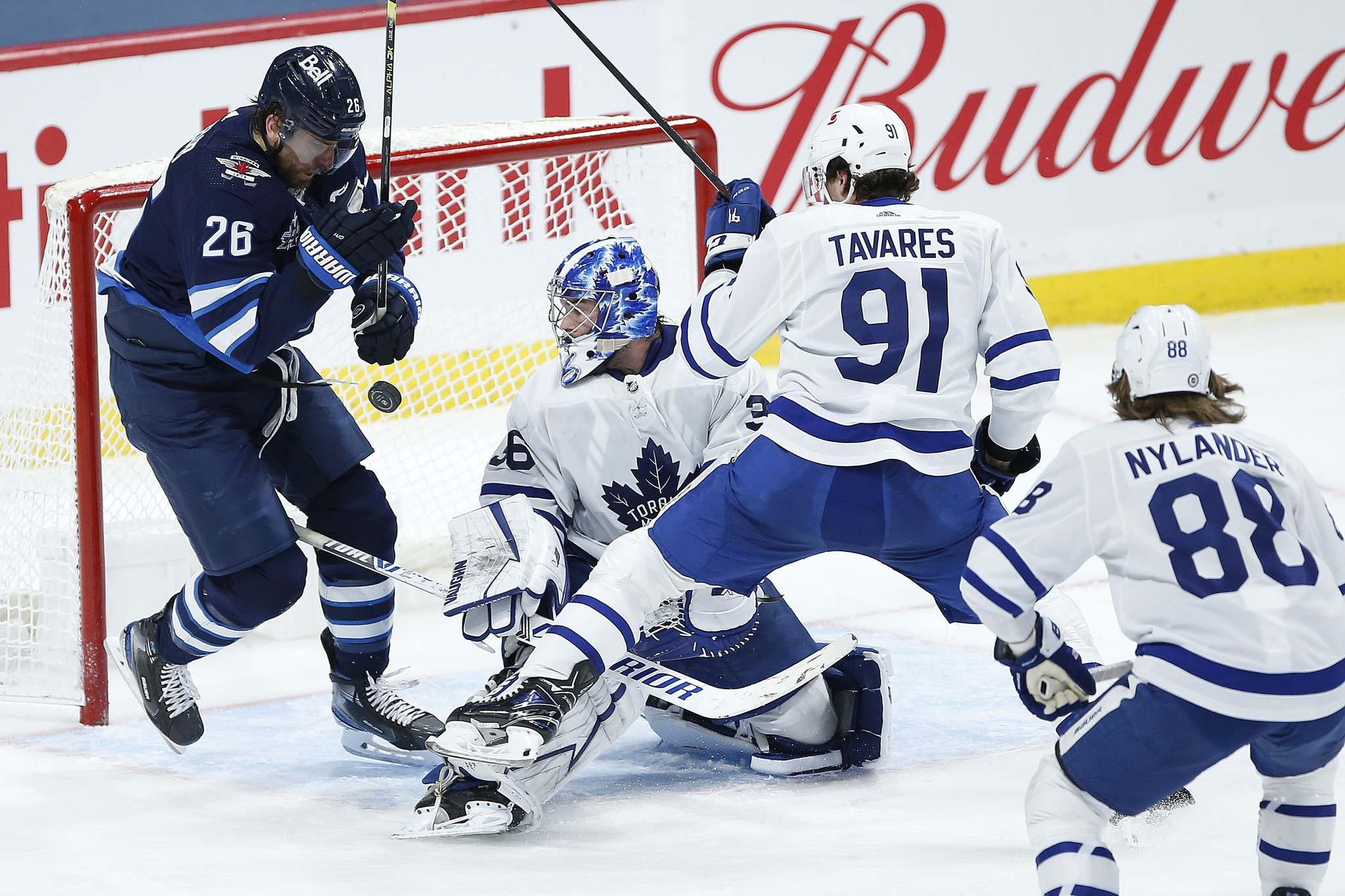 John Woods / The Canadian Press</p><p>Winnipeg Jets Captain Blake Wheeler's (left) return to the lineup was tempered by an injury to Adam Lowry and a loss to the Toronto Maple Leafs.</p>