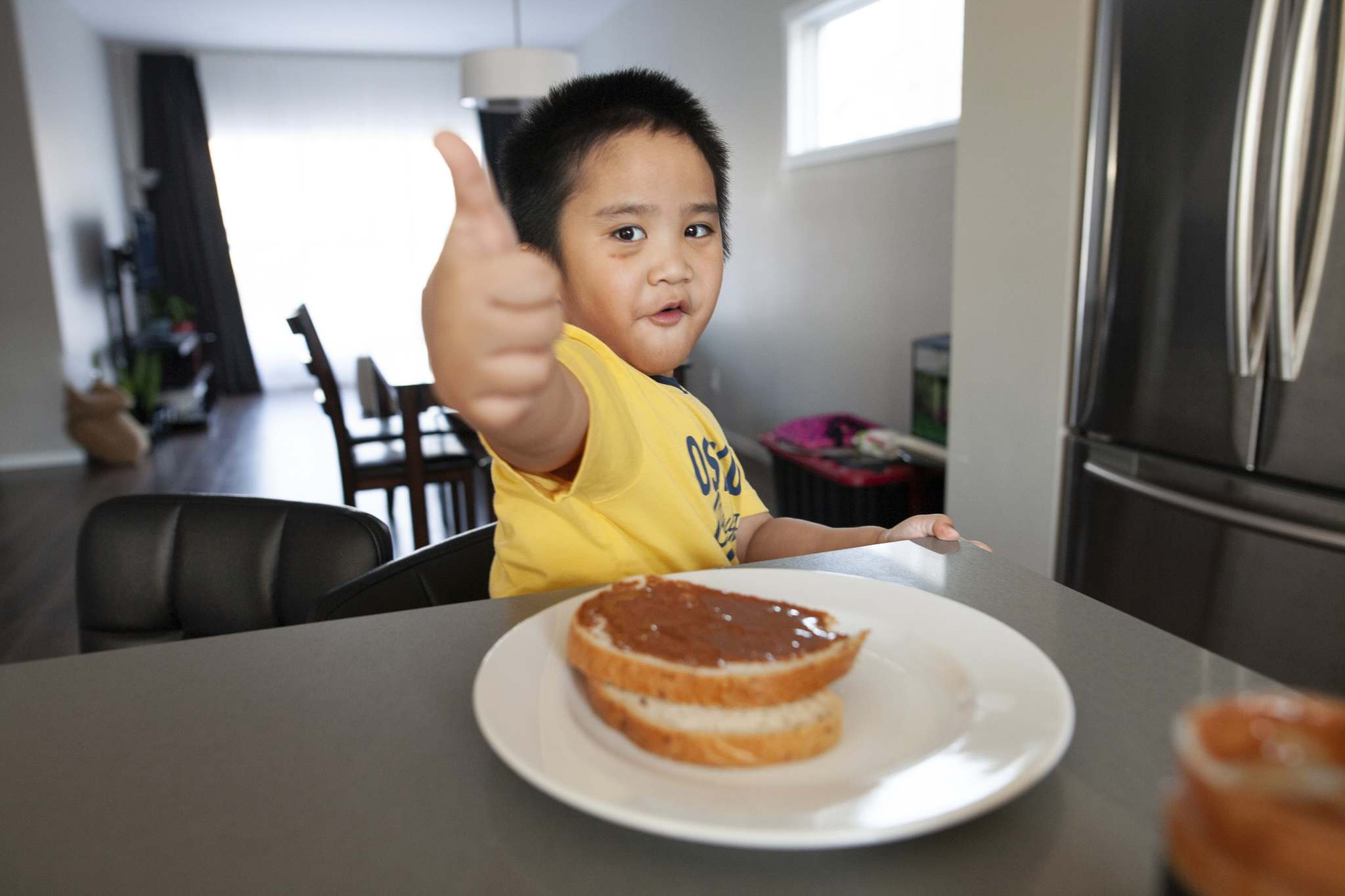 Five-year-old Riley clearly approves of his parents' peanut butter, which is available at local markets.</p>