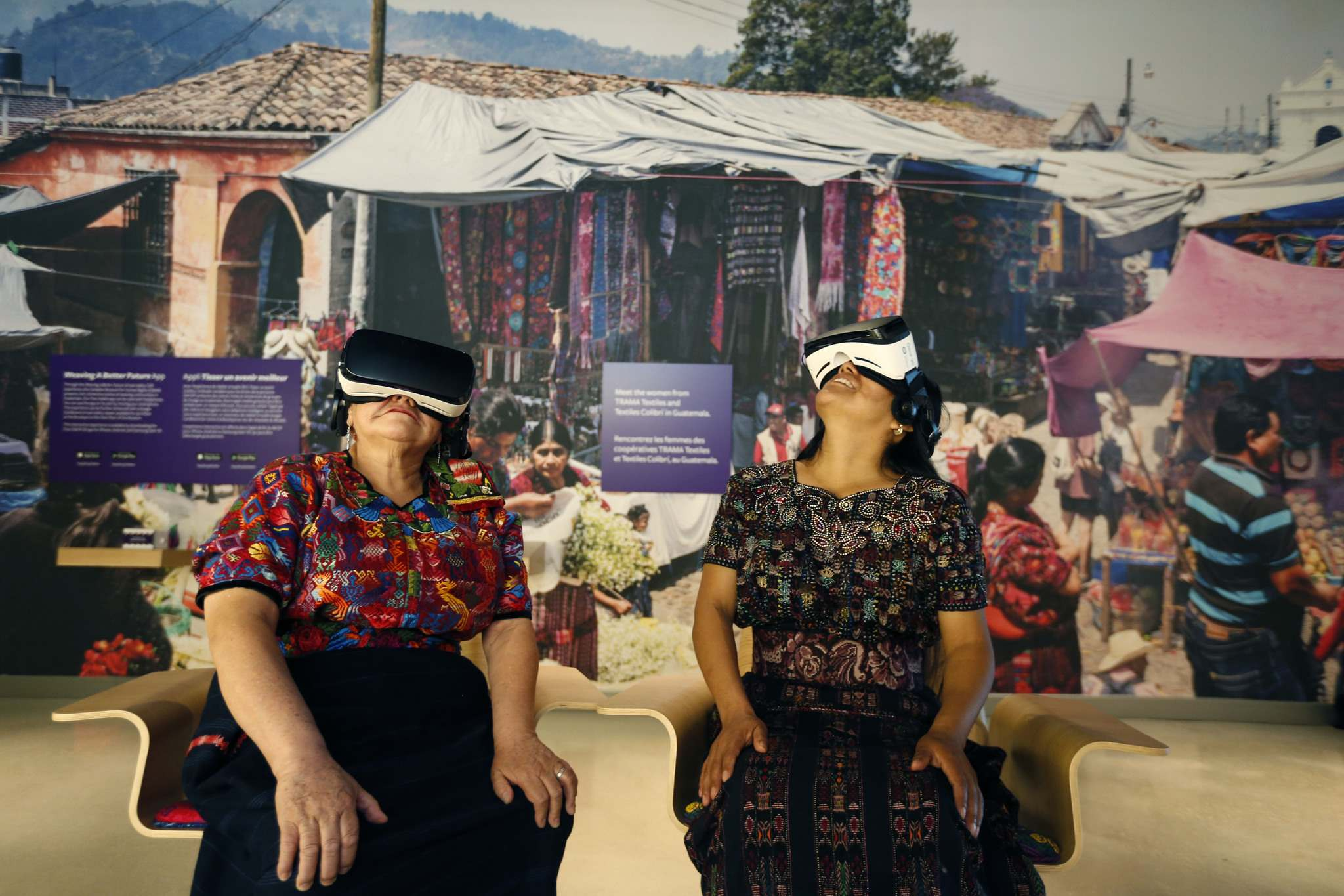 WAYNE GLOWACKI / WINNIPEG FREE PRESS</p><p>Amparo de León (left) and Oralia Chopen came from Guatemala to try the Canadian Museum for Human Rights' first 3-D virtual-reality exhibit, Empowering Women: Artisan Co-operatives that Transform Communities.</p>