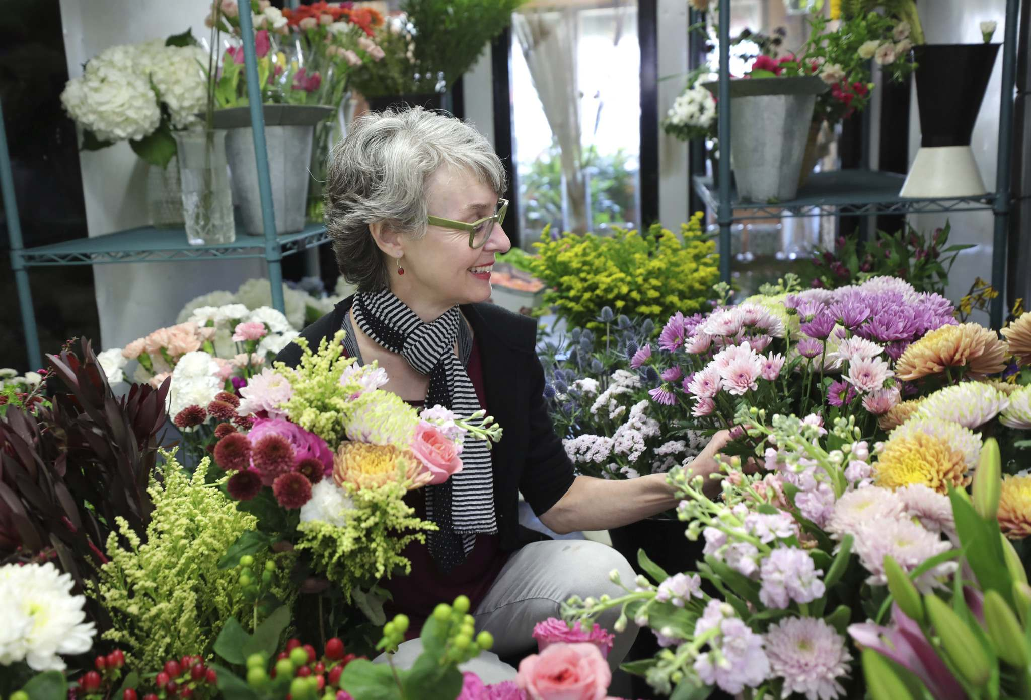 Michele Pitre, owner of Norwood Florist Design Studio, is heading into Mothers' Day, the busiest week of the year for the industry. The sector has experienced business increase by 30 per cent during the past year because people are sending more flowers since they can't meet in person. (Ruth Bonneville / Winnipeg Free Press)