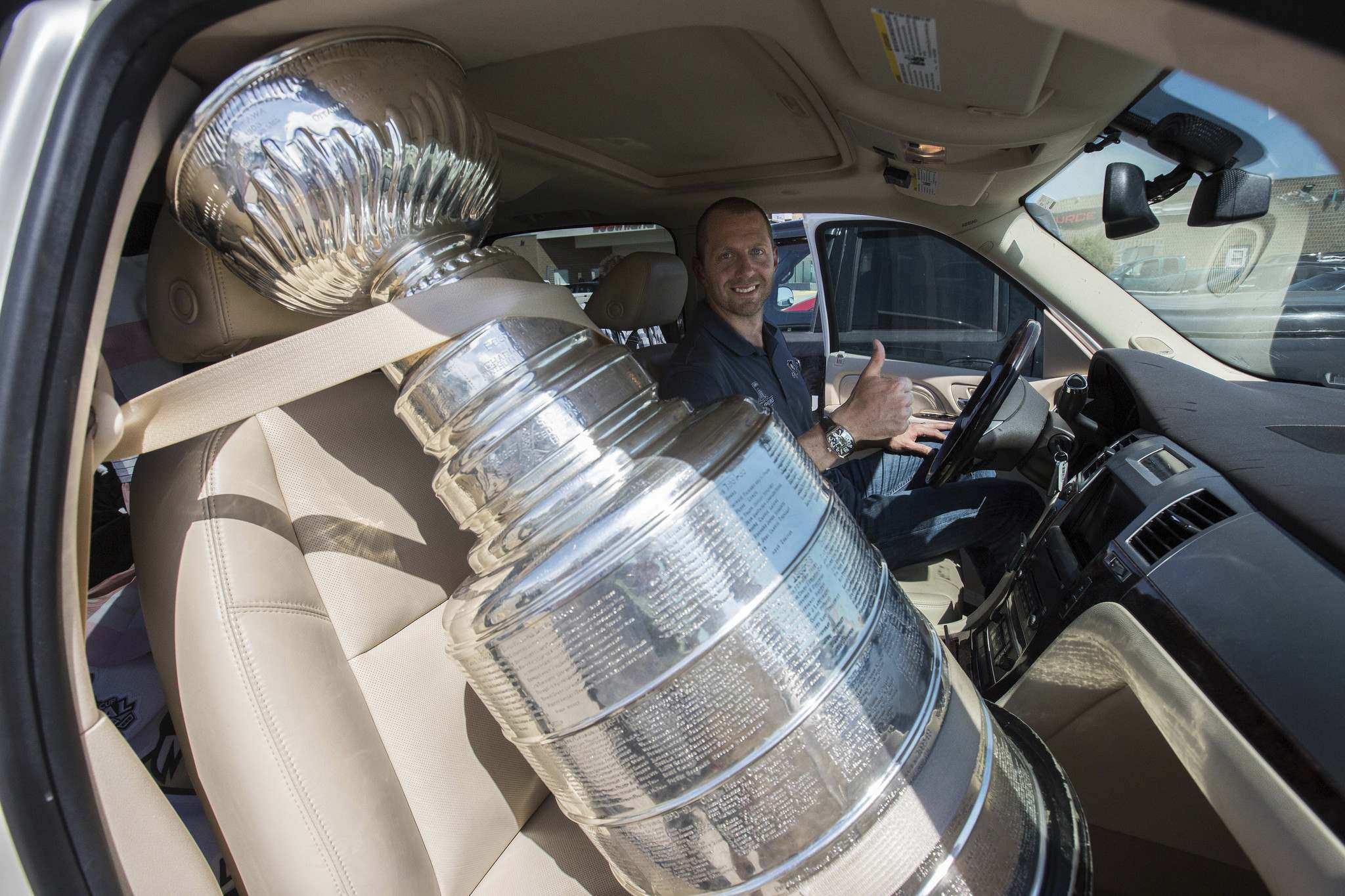 MIKE DEAL / WINNIPEG FREE PRESS</p><p>Pittsburgh Penguins forward Eric Fehr gets behind the wheel of his truck with the Stanley Cup in the passenger seat after spending the afternoon at the Southland Mall in Winkler posing with fans for photographs with the Cup.</p></p>