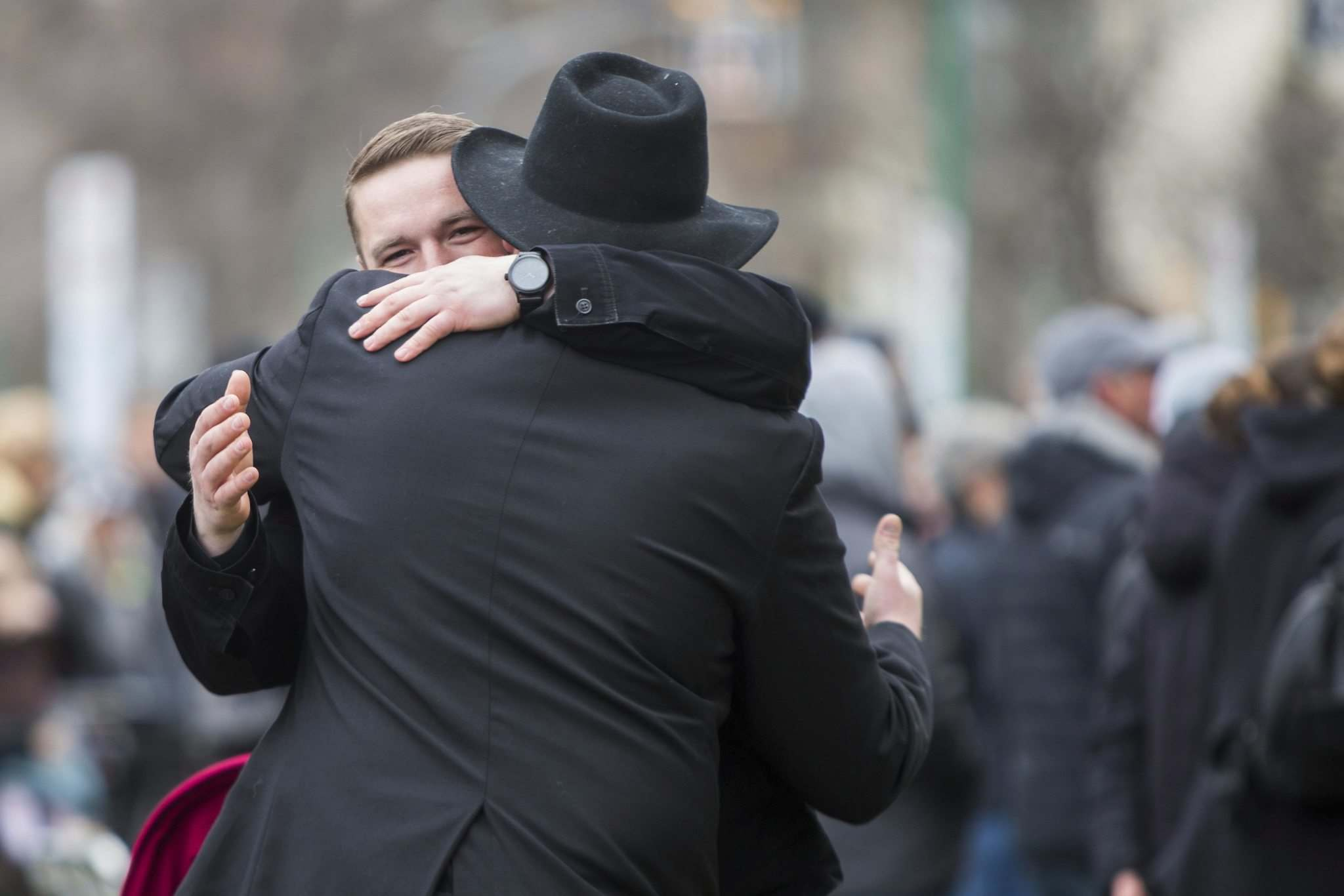In front of the Law Courts, Tobias Tissen greets a man at a protest supporting the seven churches fighting pandemic restrictions in court Monday.