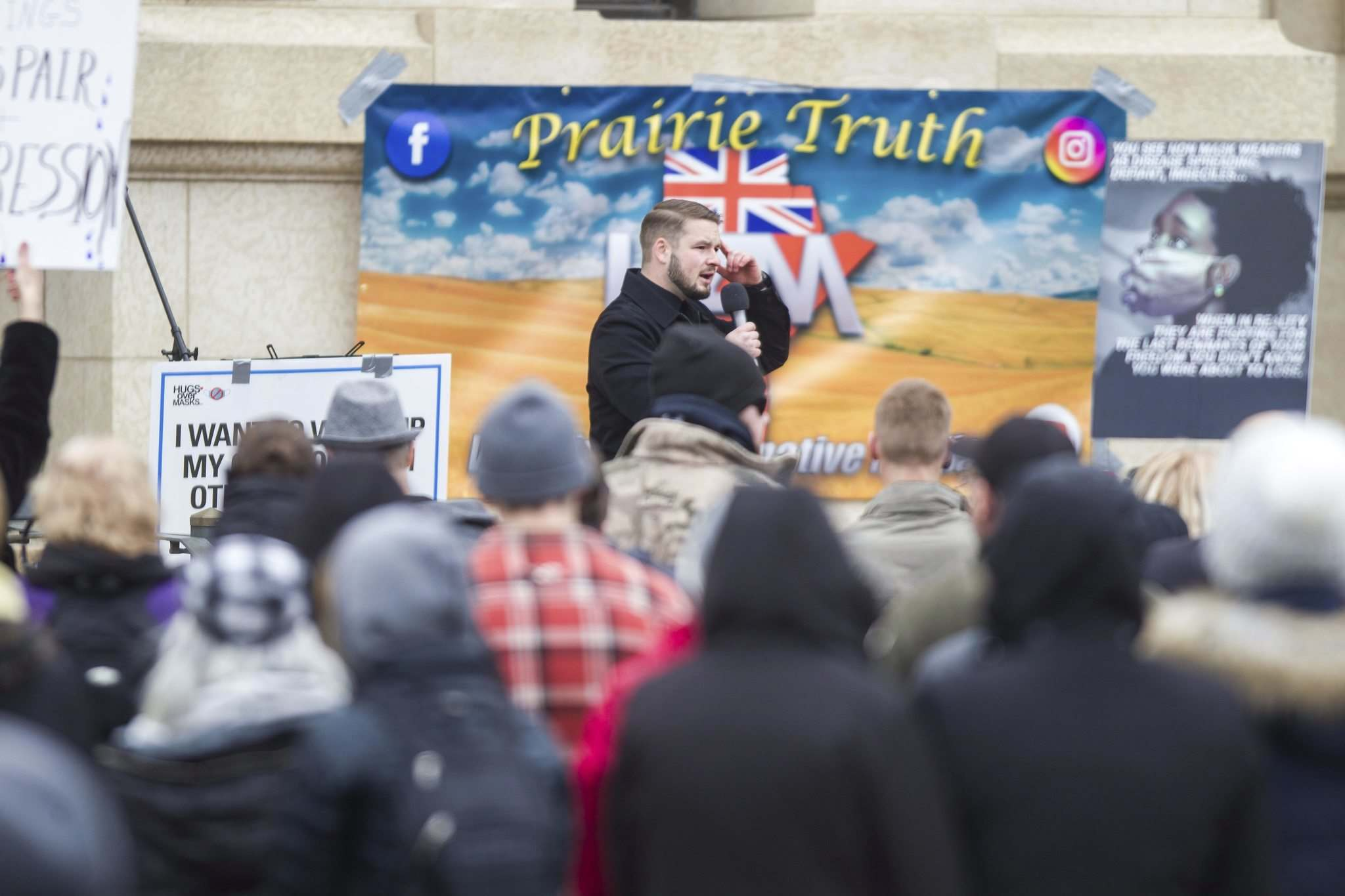 Tissen speaks at the protest supporting the seven churches fighting pandemic restrictions in court.