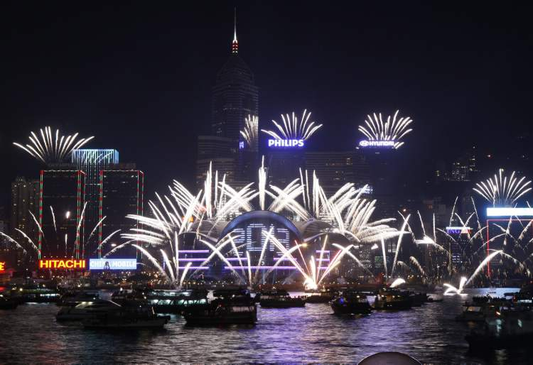 Fireworks explode at the Hong Kong Convention and Exhibition Centre over the Victoria Harbour to celebrate the 2013 New Year in Hong Kong Tuesday. (Kin Cheung / The Associated Press)