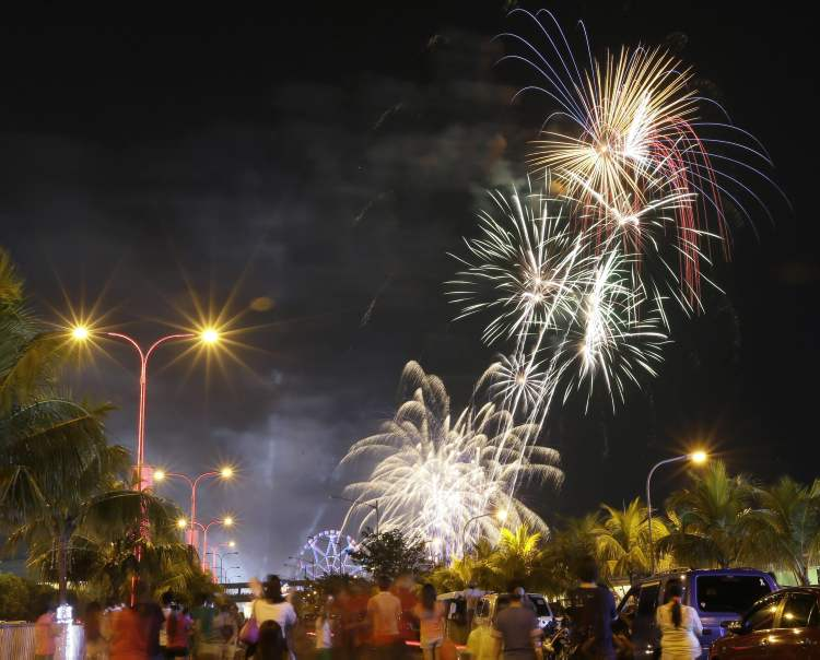 Fireworks light up the sky to welcome in the New Year at the scenic Manila Bay in Manila, Philippines. The Philippine government has been vigorously campaigning against the use of firecrackers which often result to injuries and deaths.  (The Associated Press)