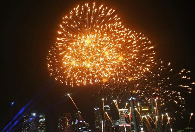 Fireworks explode over the Singapore financial district to mark the start of the new year.