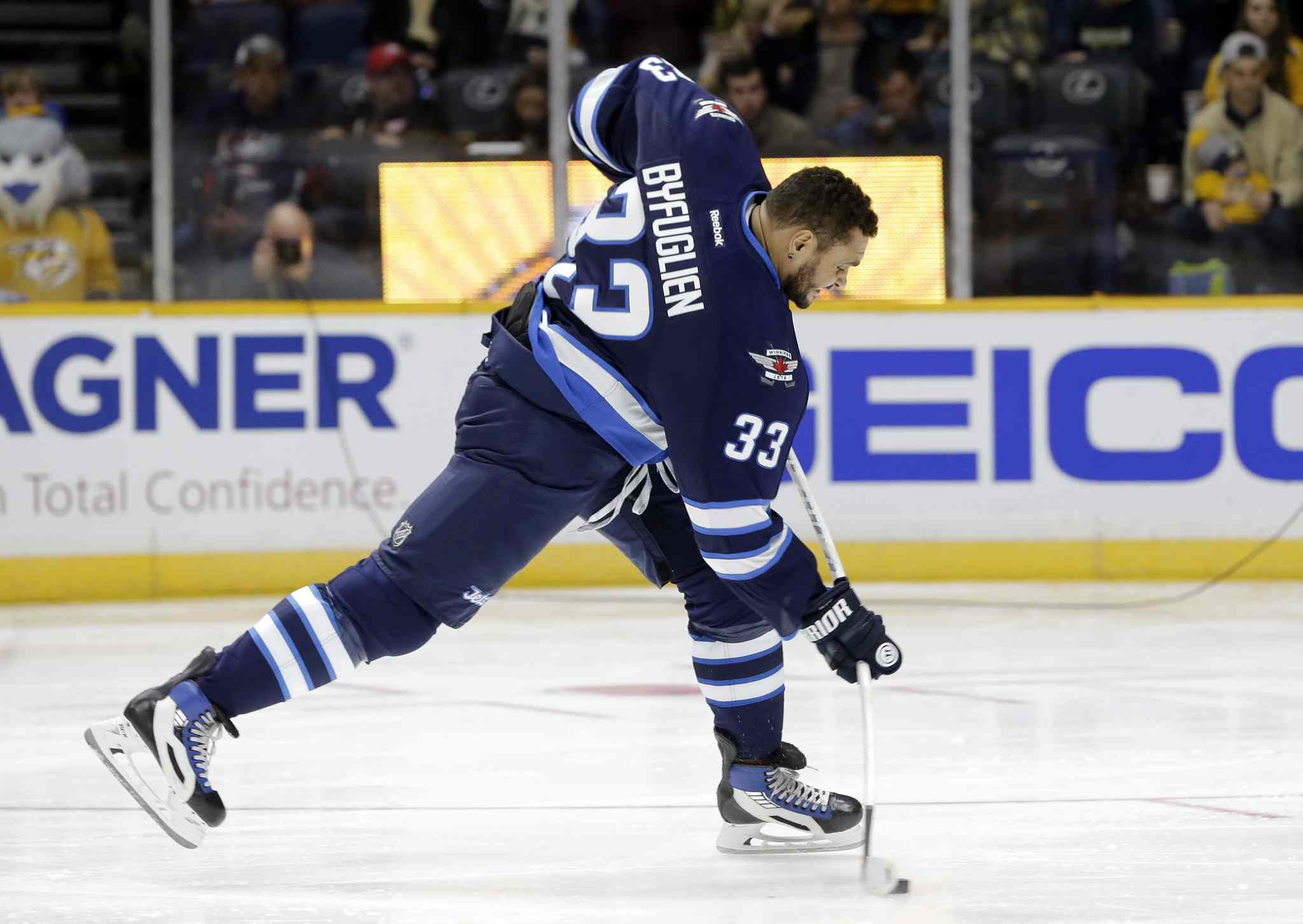 Winnipeg Jets defenseman Dustin Byfuglien (33) competes in the hardest shot competition at the NHL hockey All-Star game skills competition Saturday in Nashville.
