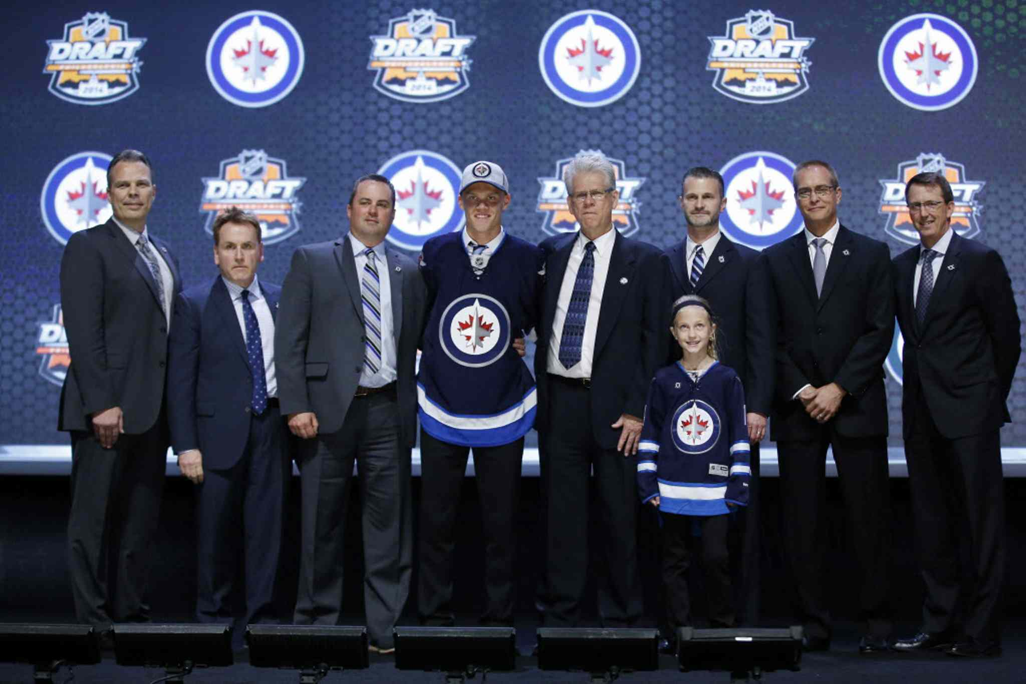 Nikolaj Ehlers stands with Winnipeg Jets officials after being chosen ninth overall during the first round of the NHL hockey draft on Friday in Philadelphia.